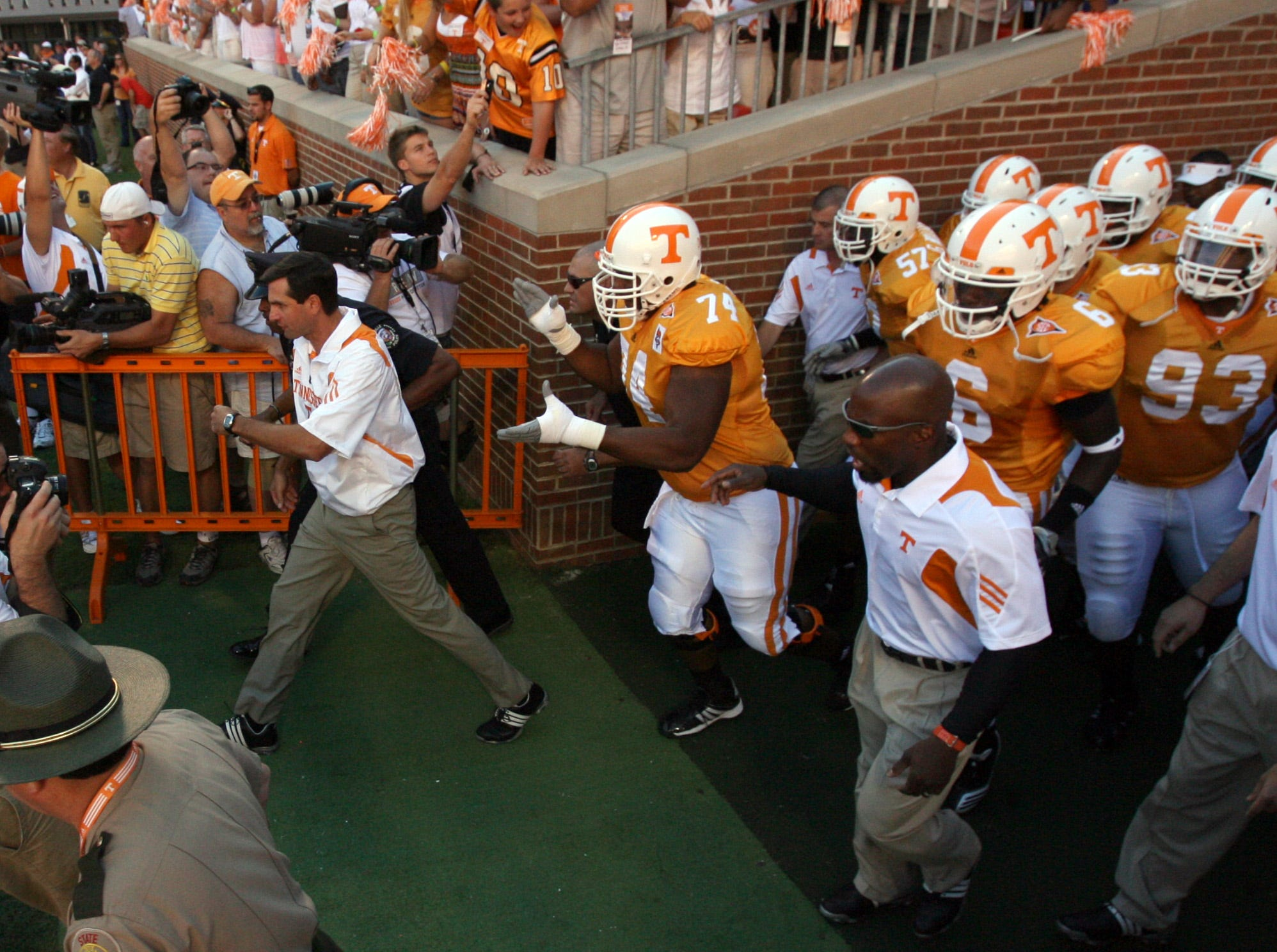 "Tennessee coach Derek Dooley leads the Vols through the ""T"" for the first time as the Dooley era begins against UT Martin Saturday, Sept. 4, 2010 at Neyland Stadium. The Vols' season opener was a 50 - 0 victory in Derek Dooley's debut as head coach."