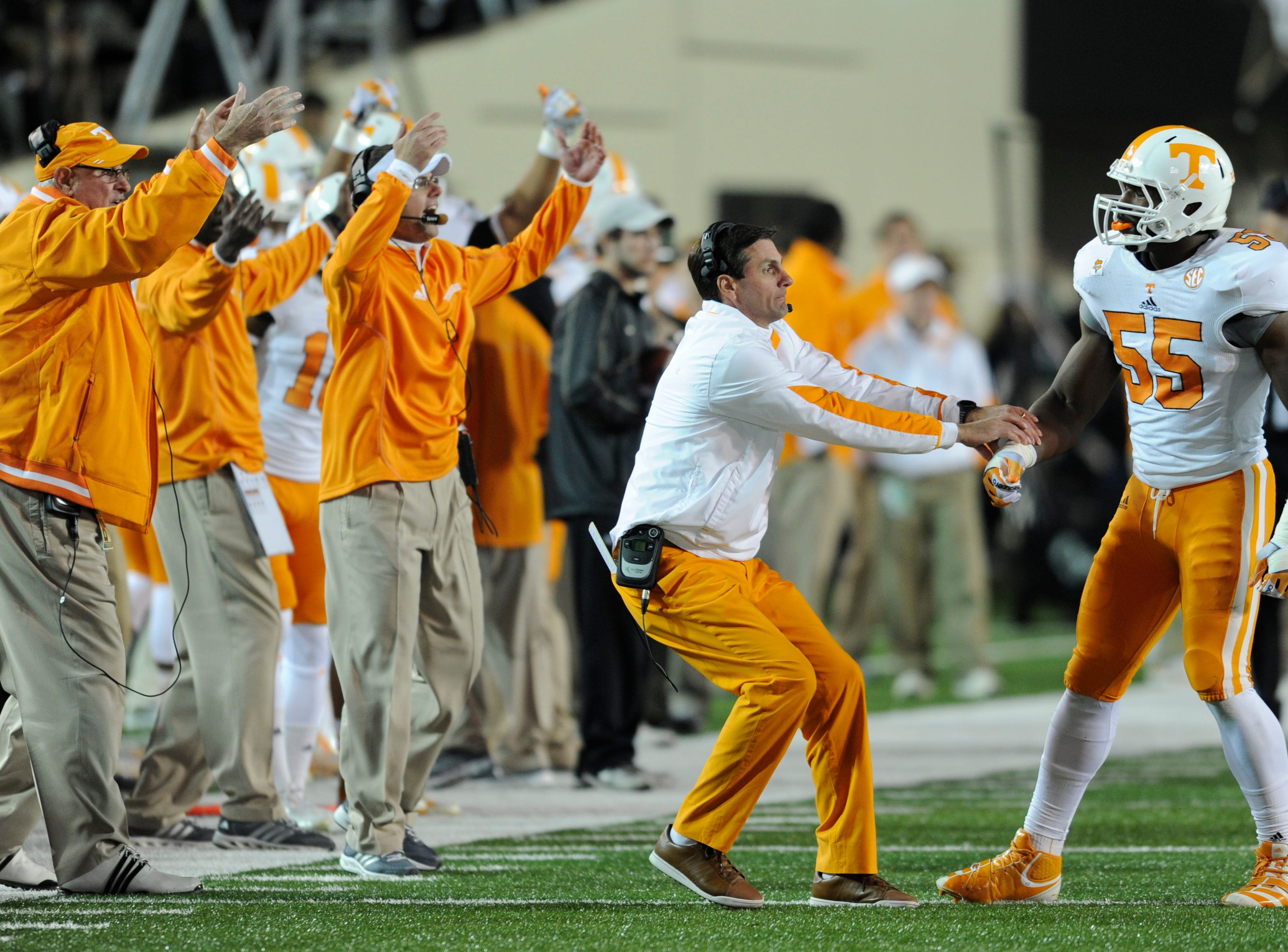 Tennessee head coach Derek Dooley pulls linebacker Jacques Smith off the field during the game against Vanderbilt at Vanderbilt Stadium in Nashville on Saturday, Nov. 17, 2012.
