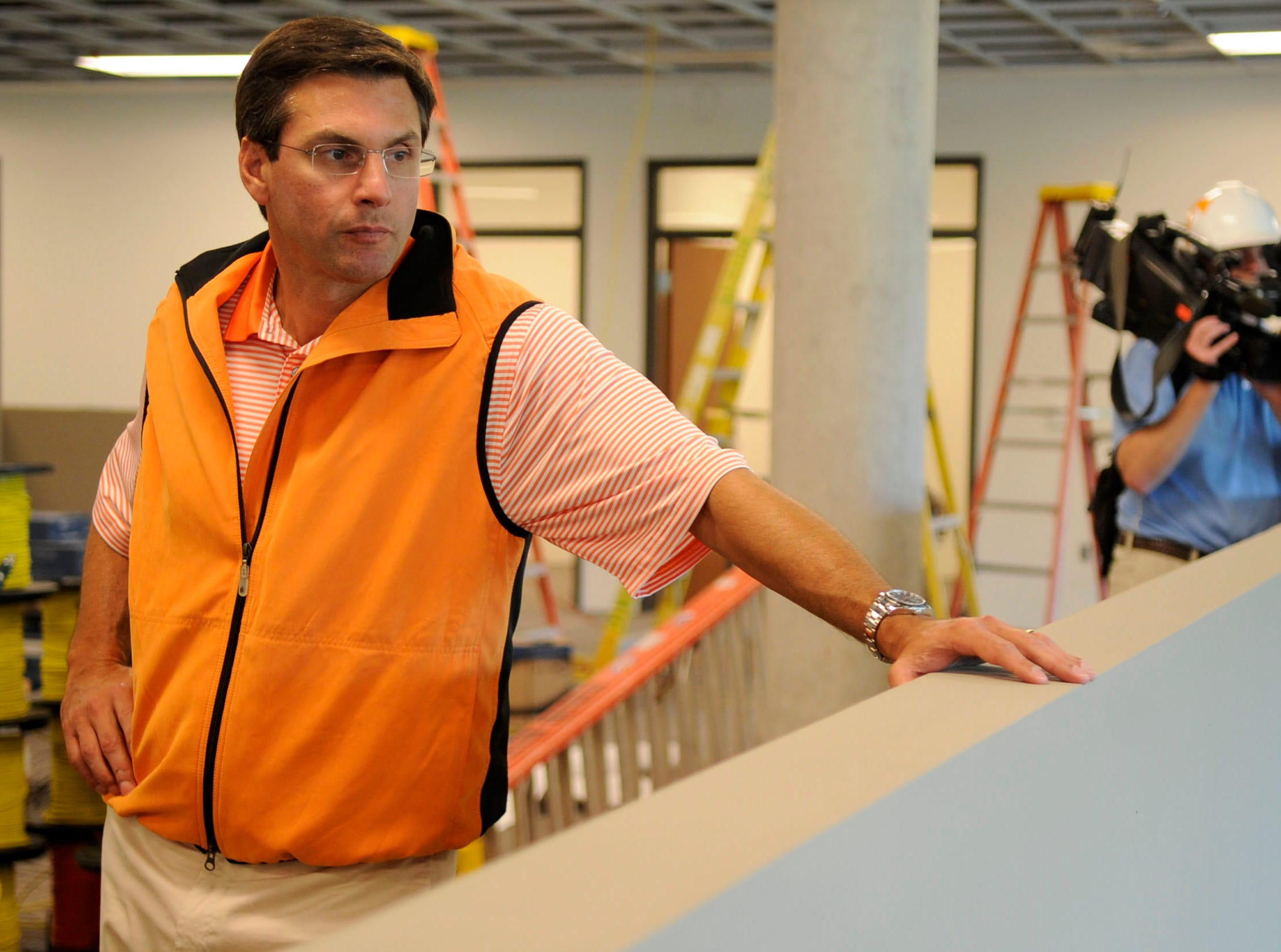 University of Tennessee head football coach Derek Dooley leads members of the media on a tour of the new Brenda Lawson Athletic Center and Neyland-Thompson Sports Center on Friday, July 27, 2012. The 145,000-square-foot practice facility is slated for completion this fall.