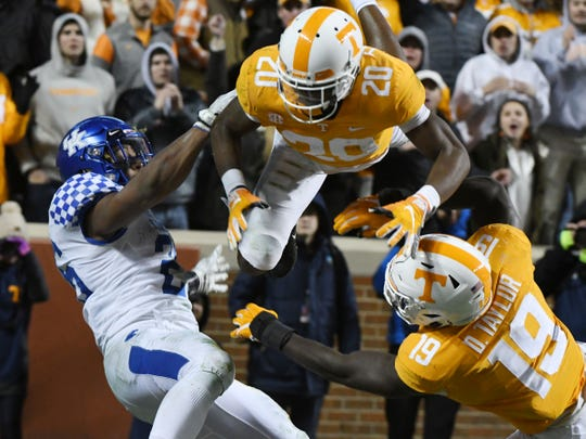 Tennessee defensive back Bryce Thompson (20) goes airborne to break up a pass intended for Kentucky's Benny Snell Jr. (26).