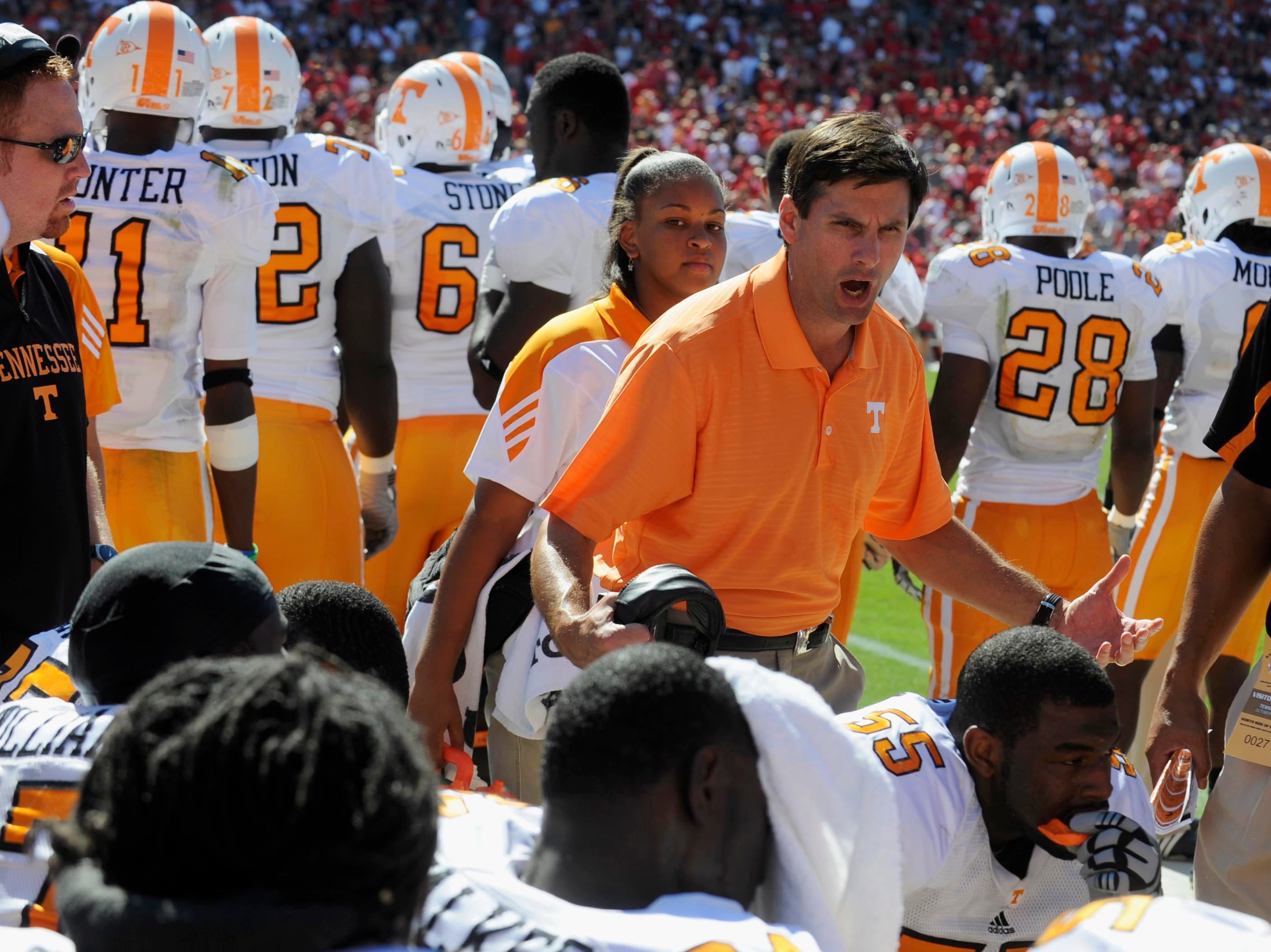 "Tennessee head coach Derek Dooley yells, ""don't look at the score, play football."" at his players on the bench during the second half Saturday, Oct. 9, 2010 in Sanford Stadium in Athens, GA."