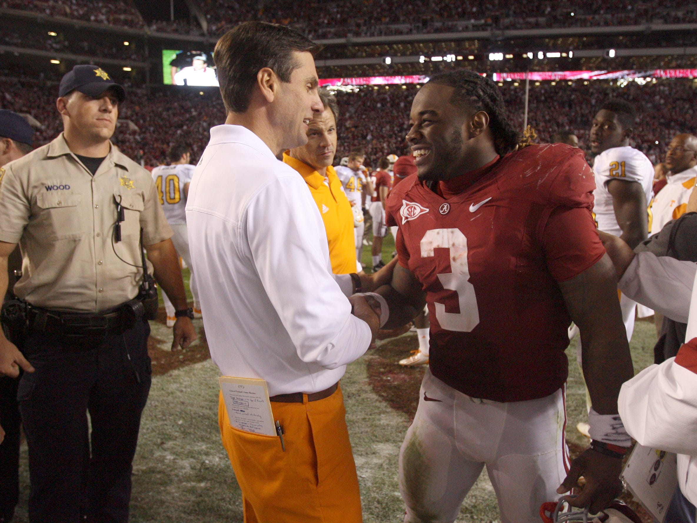Tennessee head coach Derek Dooley talks with Alabama running back Trent Richardson (3) after the Vols lost 37-6 to the Crimson Tide at Bryant-Denny Stadium in Tuscaloosa, Ala., Saturday, Oct. 22, 2011.