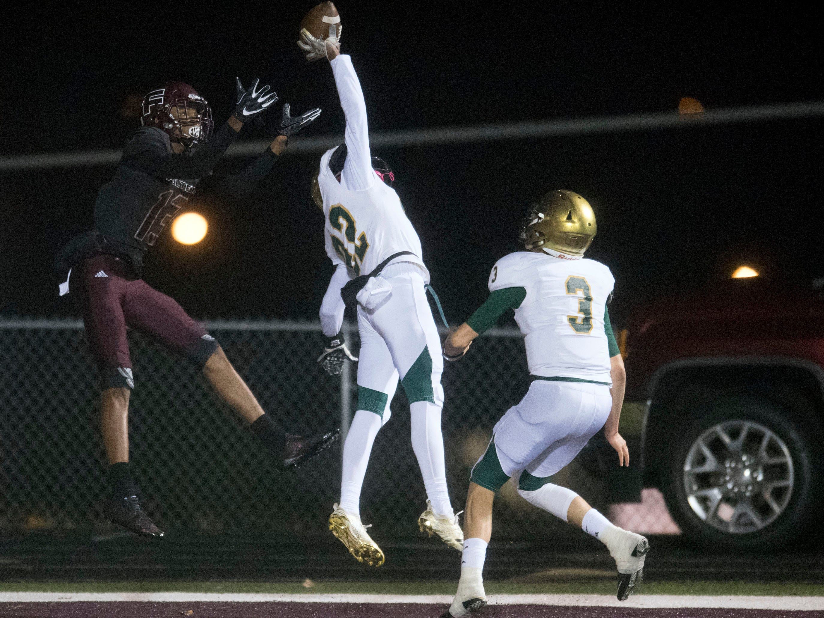 Knoxville Catholic's Seth Lawson (42) breaks up a pass intended for Fulton's Amir Johnson (13). Knoxville Catholic beat Fulton, 28-25 in the second round of the Class 5A playoffs on Friday, November 9, 2018.