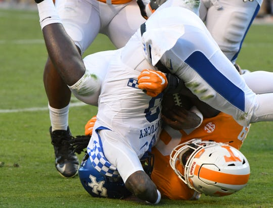 Tennessee linebacker Darrell Taylor (19) sacks Kentucky quarterback Terry Wilson (3) during first half action Saturday, November 10, 2018 at Neyland Stadium in Knoxville, Tenn.