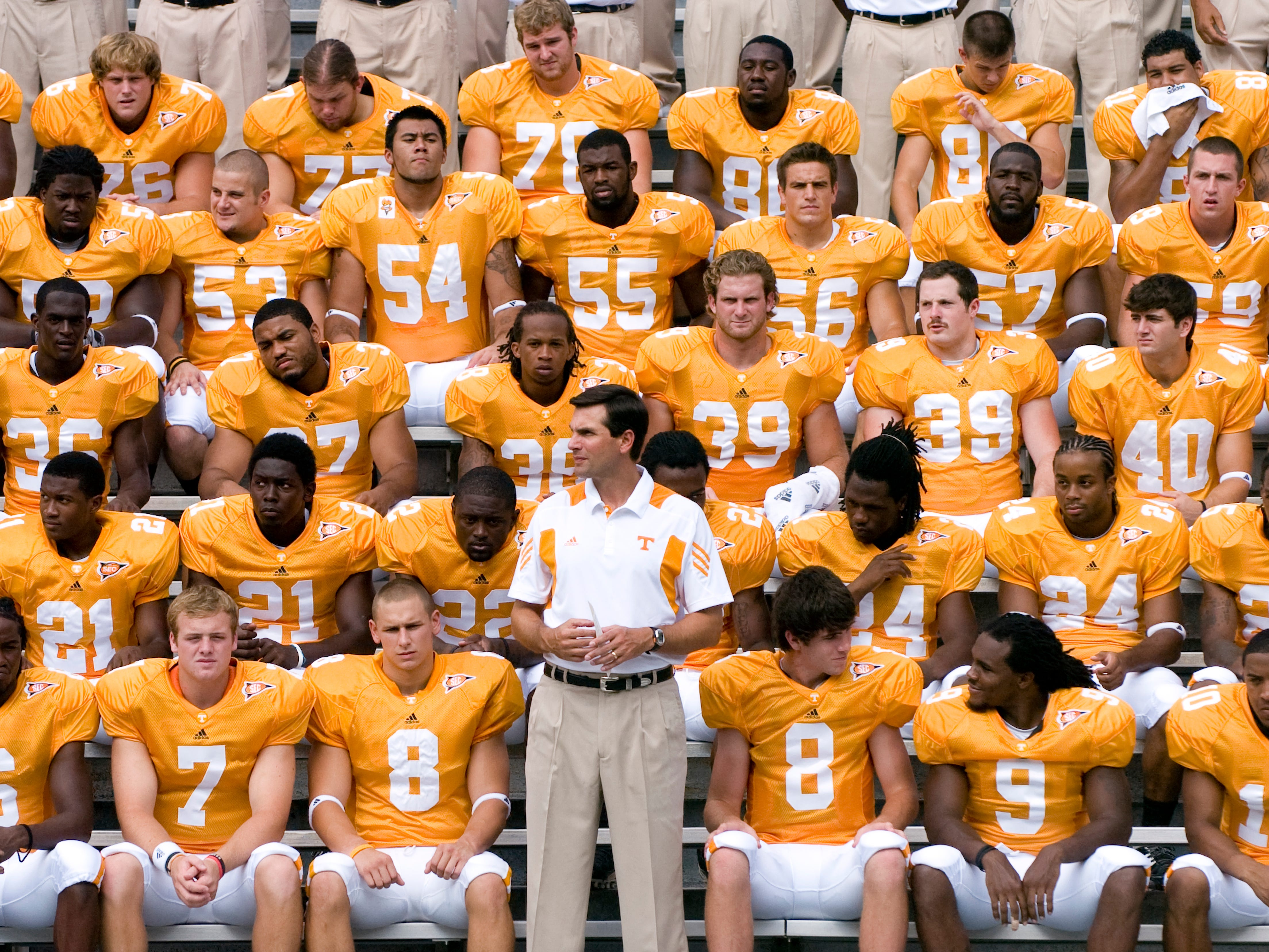 Tennessee head coach Derek Dooley stands with the Tennessee football team just before having their group photograph taken. 