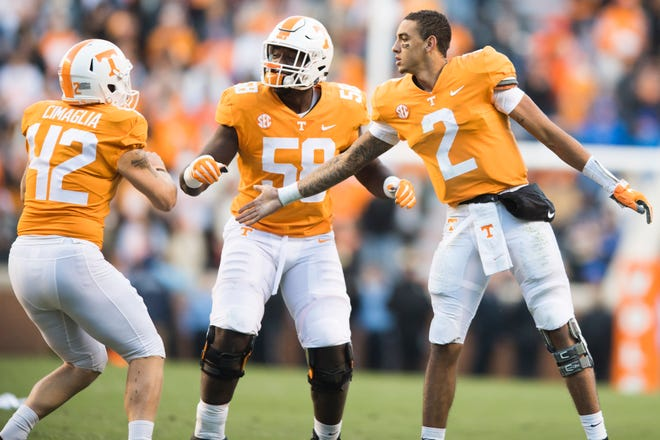 Tennessee quarterback Jarrett Guarantano (2) and offensive lineman Jahmir Johnson (58) congratulate placekicker Brent Cimaglia (42) on his field goal Saturday.