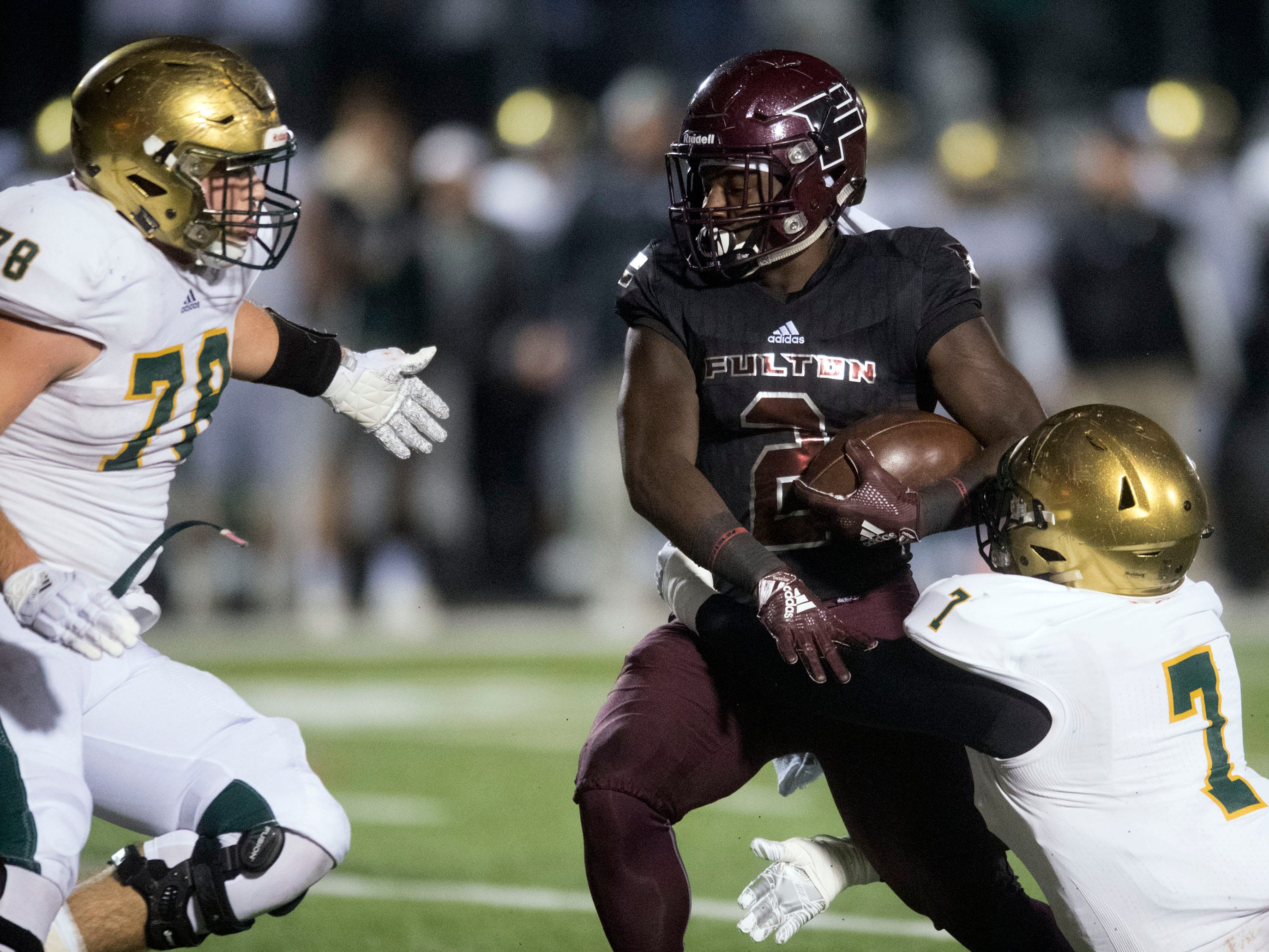 Fulton's JaShaun Fenderson (2) tries to fight off Knoxville Catholic's Stiles Moore (7) and Cooper Mays (78). Knoxville Catholic beat Fulton, 28-25 in the second round of the Class 5A playoffs on Friday, November 9, 2018.