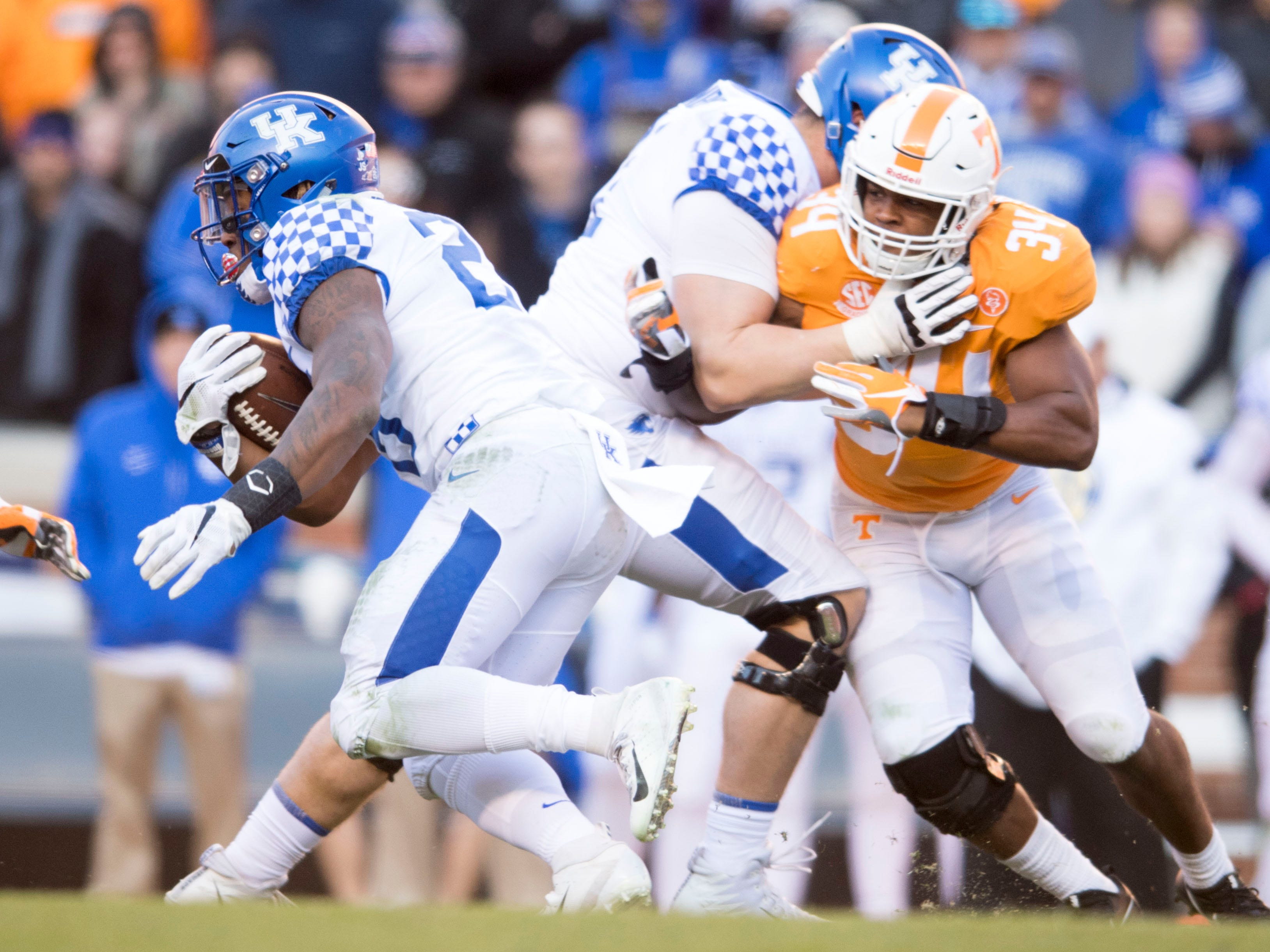 Tennessee linebacker Darrin Kirkland Jr. (34)  tries to break through to Kentucky wide receiver Dorian Baker (2) during a game between Tennessee and Kentucky at Neyland Stadium in Knoxville, Tennessee on Saturday, November 10, 2018.