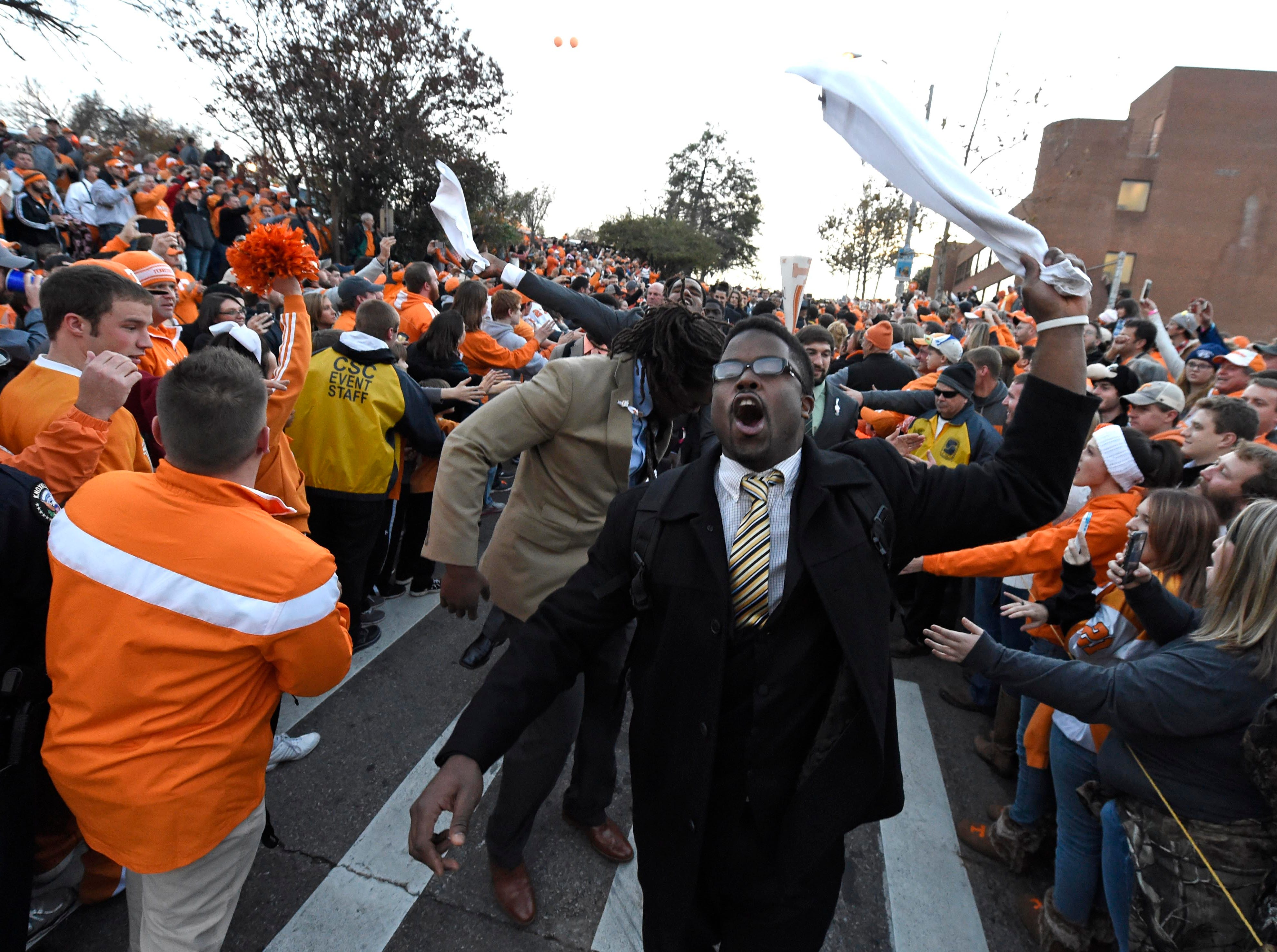 Tennessee football players whoop with fans while descending the Vol Walk before the game against Missouri at Neyland Stadium, Saturday, Nov.22, 2014 in Knoxville, Tenn.