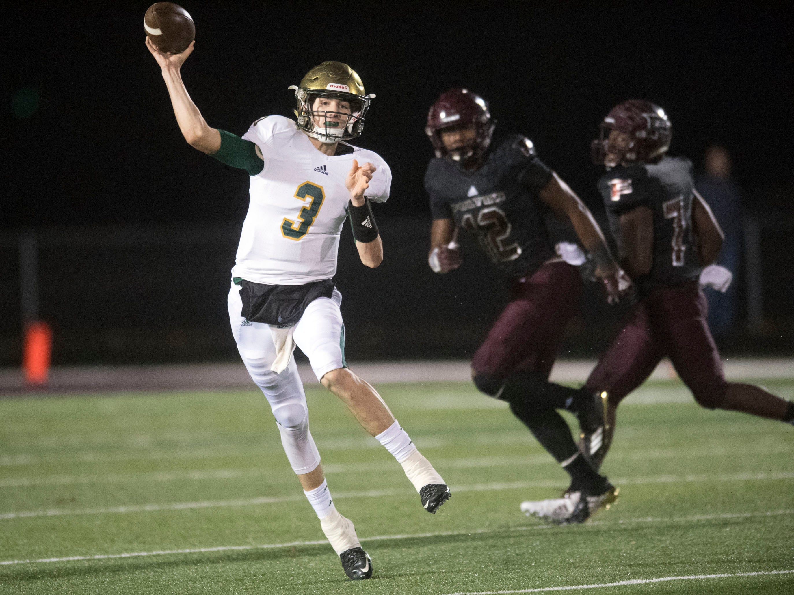 Knoxville Catholic's Jack Jancek (3) throws to a receiver. Knoxville Catholic beat Fulton, 28-25 in the second round of the Class 5A playoffs on Friday, November 9, 2018.