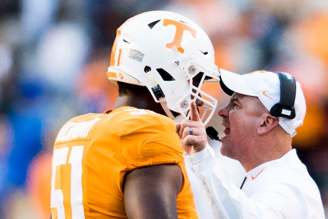 Tennessee Head Coach Jeremy Pruitt yells at Tennessee offensive lineman Drew Richmond (51) after an altercation on the field between opposing team players during a game between Tennessee and Kentucky at Neyland Stadium in Knoxville, Tennessee on Saturday, November 10, 2018.