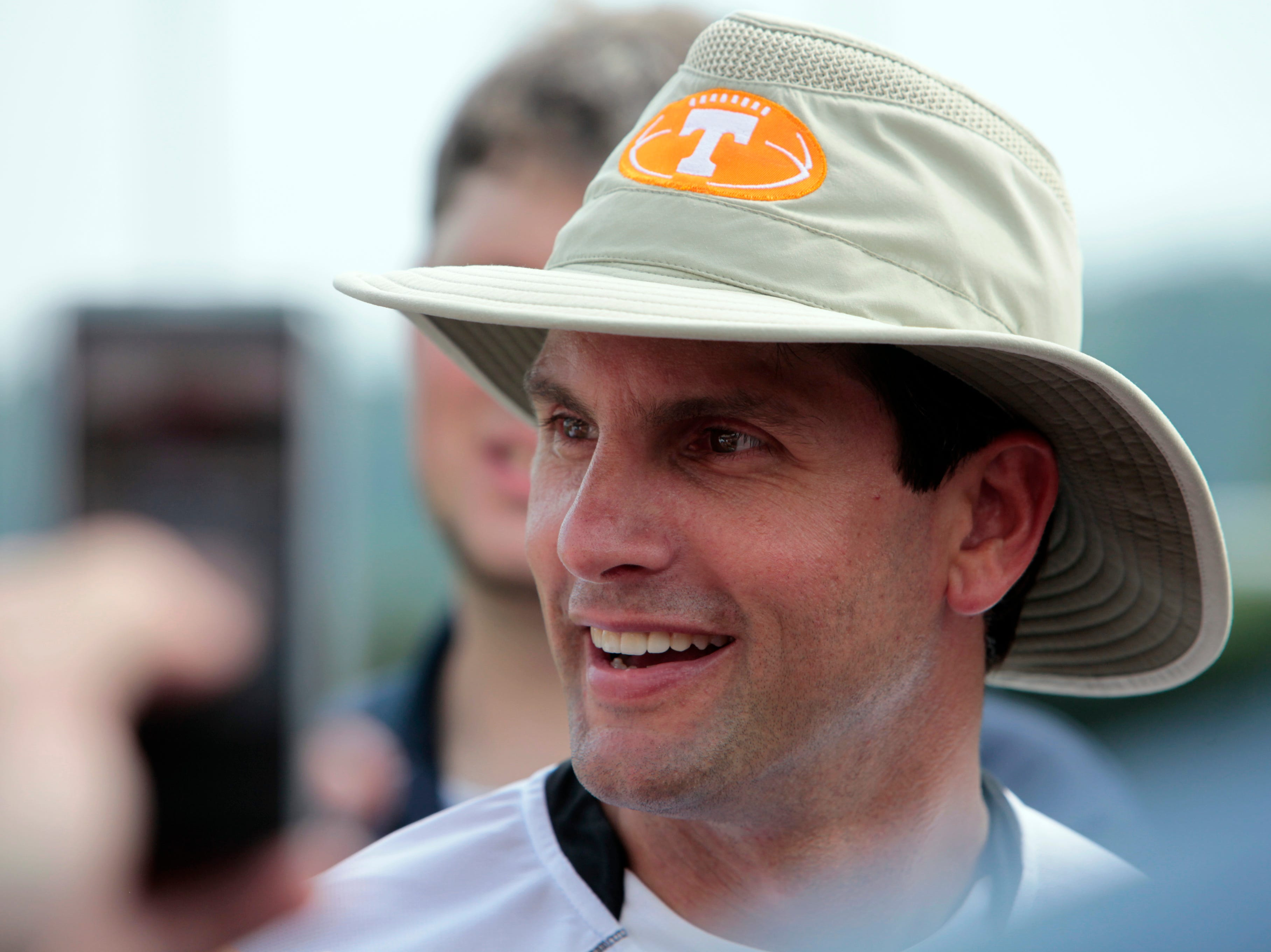 Head coach Derek Dooley talks to the media after the Vols' first official practice of the season at Haslam Field at the University of Tennessee Wednesday, Aug. 4, 2010.