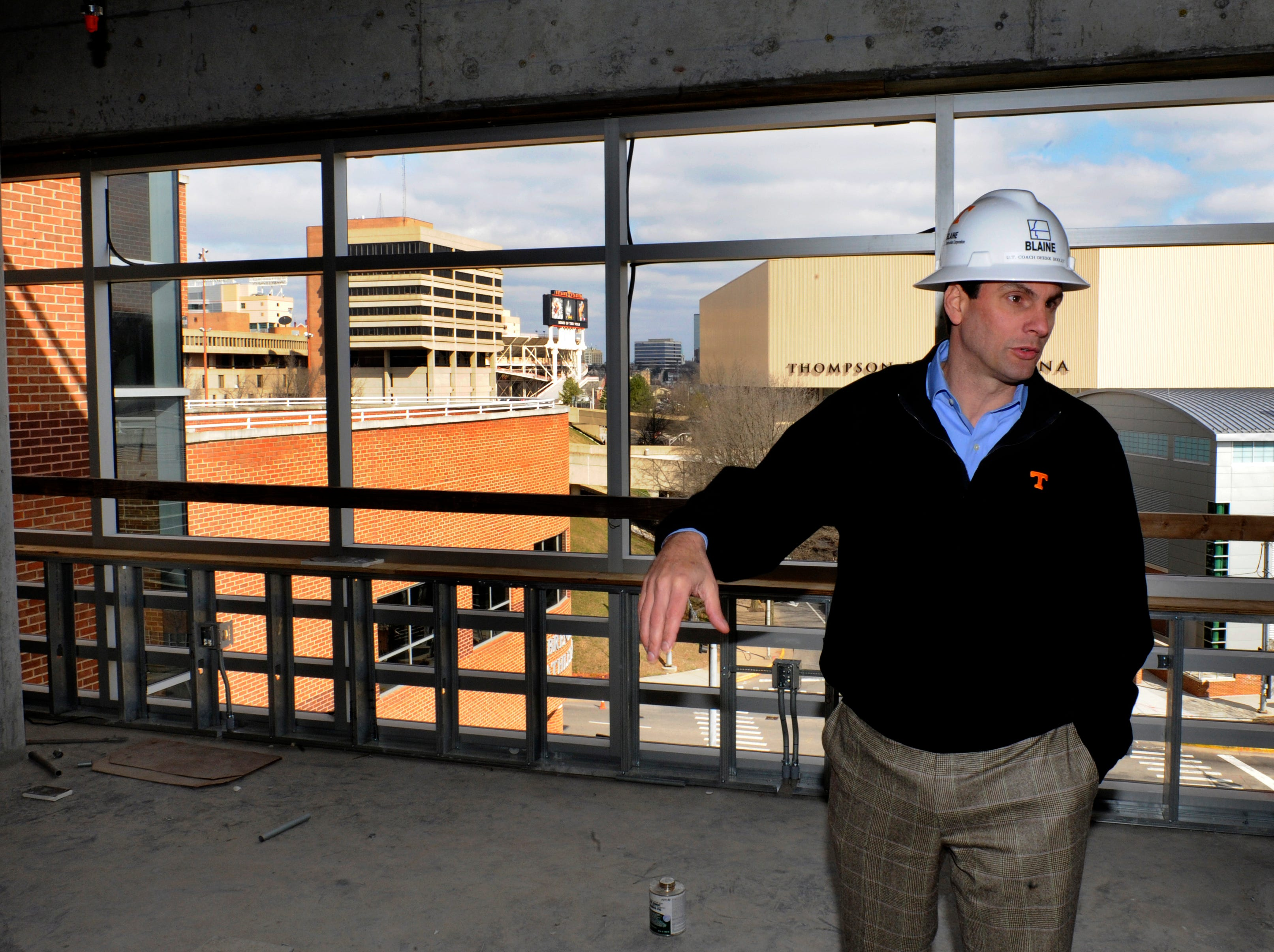 Coach Derek Dooley shows off the new Football Training Center Thursday at the University of Tennessee. The $45 million project is scheduled for completion this summer.
