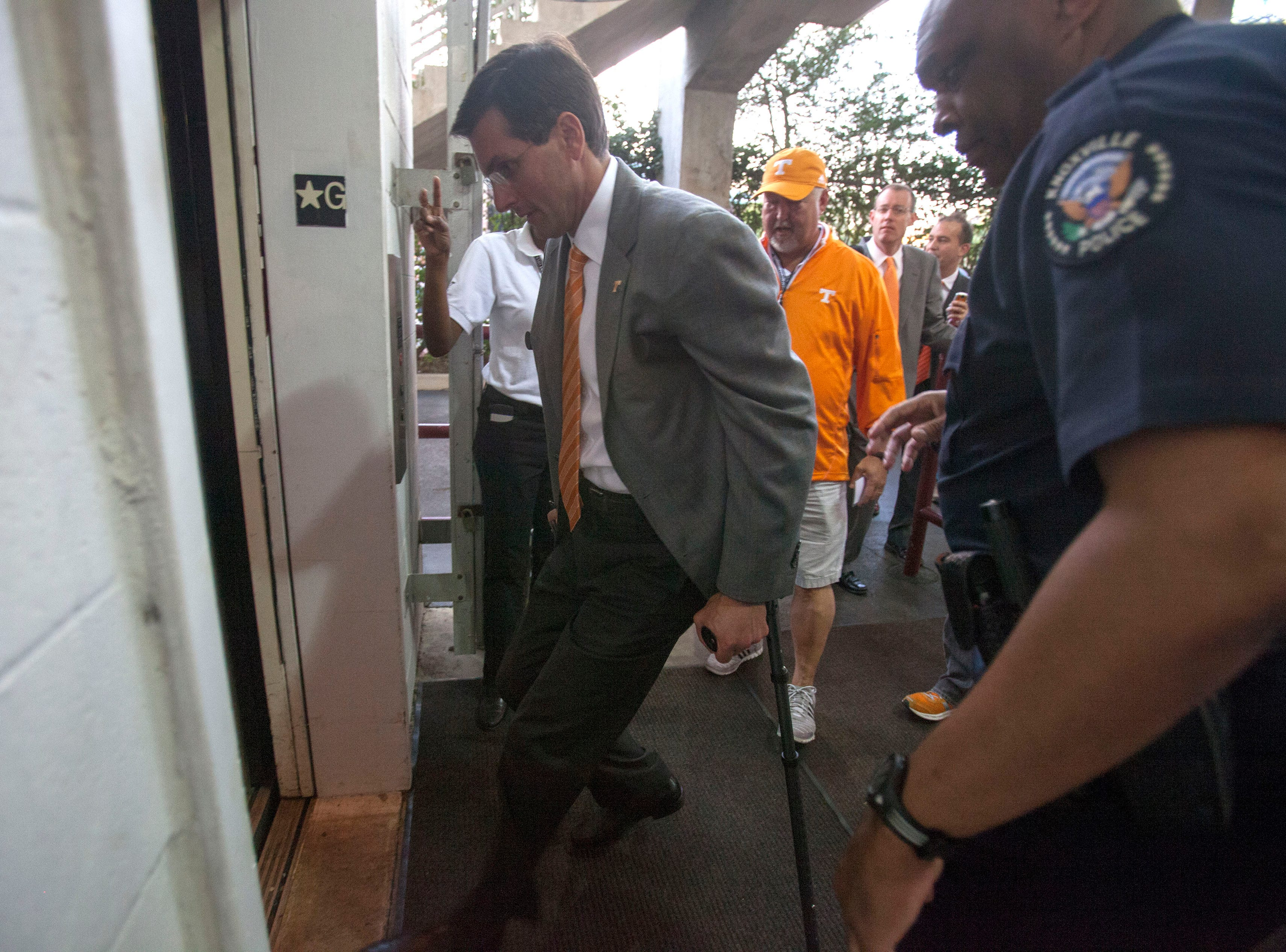 Tennessee head coach Derek Dooley boards an elevator to the press box level in Davis Wade Stadium before the Volunteers matchup against the Mississippi State Bulldogs  in Starkville, Miss., Saturday, Oct. 13, 2012. Dooley underwent hip surgery earlier this week and will be coaching the game from the press box.