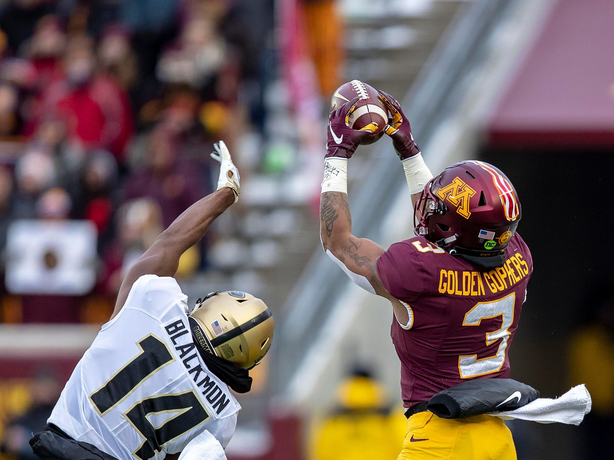 Nov 10, 2018; Minneapolis, MN, USA; Minnesota Golden Gophers wide receiver Chris Autman-Bell (3) jumps over Purdue Boilermakers cornerback Antonio Blackmon (14) to attempt to catch a pass in the first half at TCF Bank Stadium. Mandatory Credit: Jesse Johnson-USA TODAY Sports