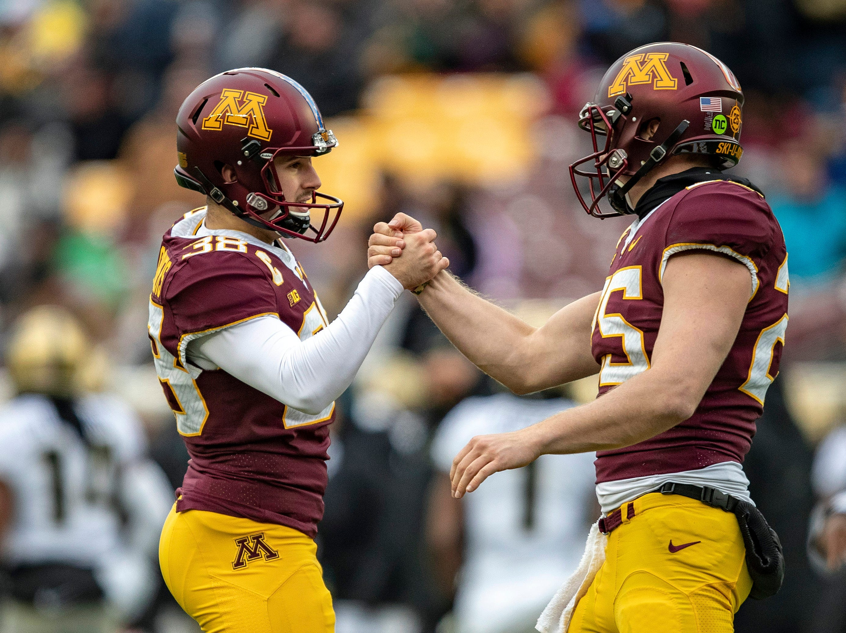 Nov 10, 2018; Minneapolis, MN, USA; Minnesota Golden Gophers place kicker Emmit Carpenter (38) celebrates with Minnesota Golden Gophers long snapper Payton Jordahl (25) after making a field goal in the first quarter against the Purdue Boilermakers at TCF Bank Stadium. Mandatory Credit: Jesse Johnson-USA TODAY Sports