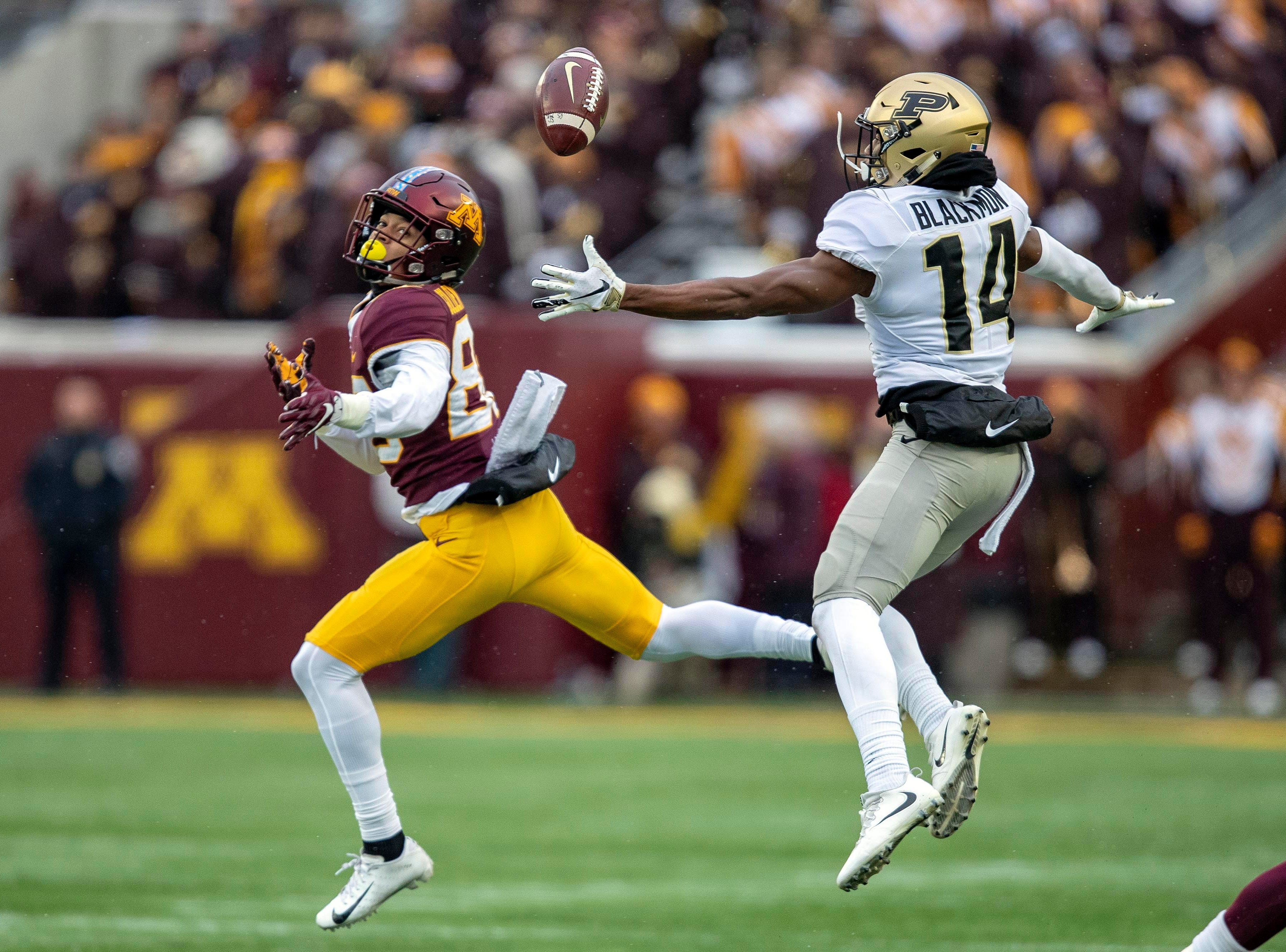Nov 10, 2018; Minneapolis, MN, USA; Minnesota Golden Gophers wide receiver Demetrius Douglas (82) and Purdue Boilermakers cornerback Antonio Blackmon (14) attempt to catch a deflected ball during the first half at TCF Bank Stadium. Mandatory Credit: Jesse Johnson-USA TODAY Sports