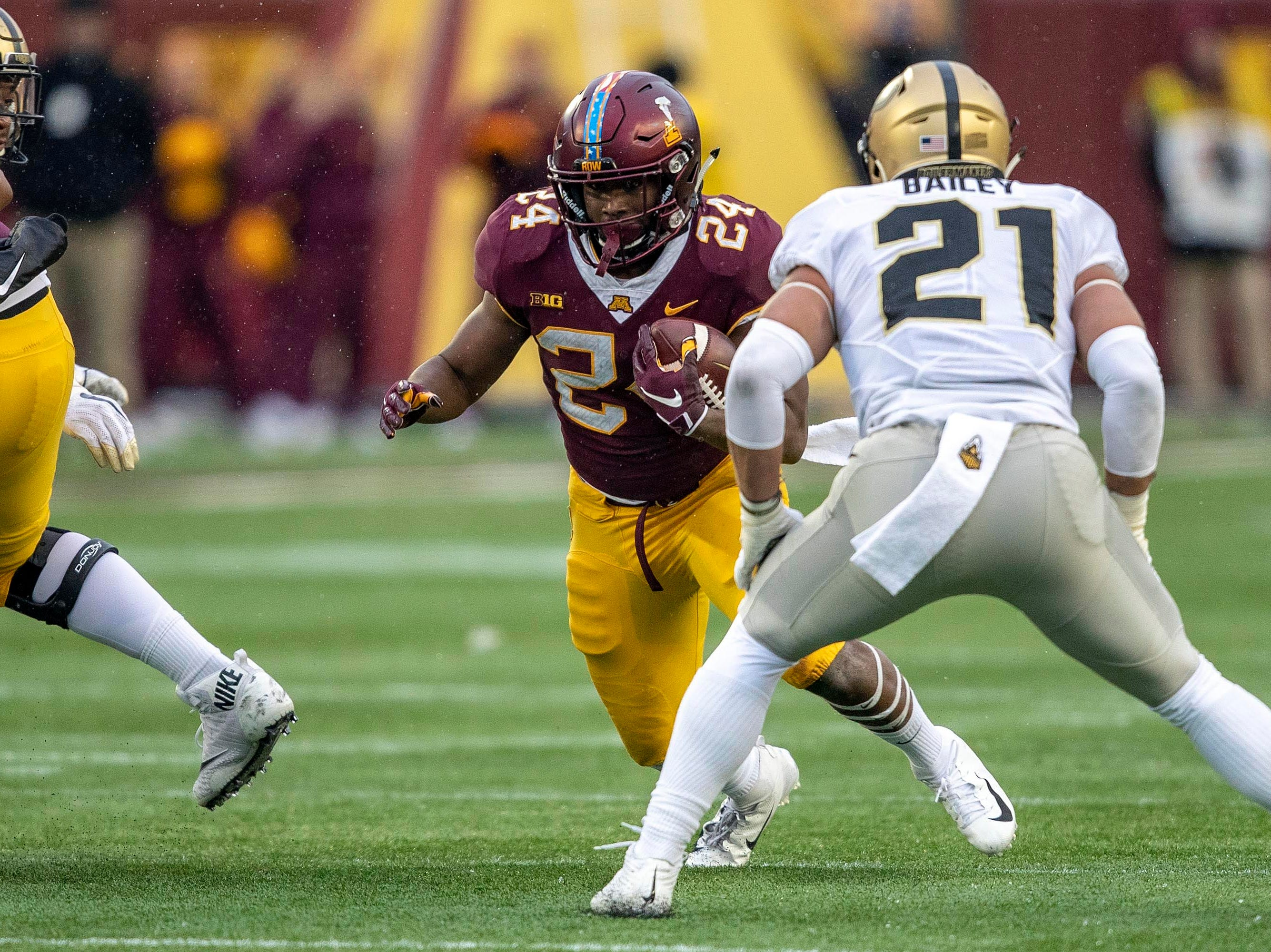Nov 10, 2018; Minneapolis, MN, USA; Minnesota Golden Gophers running back Mohamed Ibrahim (24) rushes with the ball as Purdue Boilermakers linebacker Markus Bailey (21) plays defense in the first half at TCF Bank Stadium. Mandatory Credit: Jesse Johnson-USA TODAY Sports