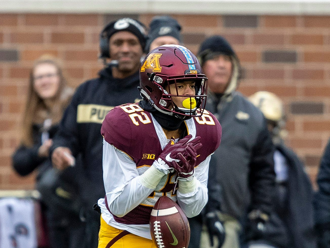Nov 10, 2018; Minneapolis, MN, USA; Minnesota Golden Gophers wide receiver Demetrius Douglas (82) attempts to catch a pass in the first half against the Purdue Boilermakers at TCF Bank Stadium. Mandatory Credit: Jesse Johnson-USA TODAY Sports