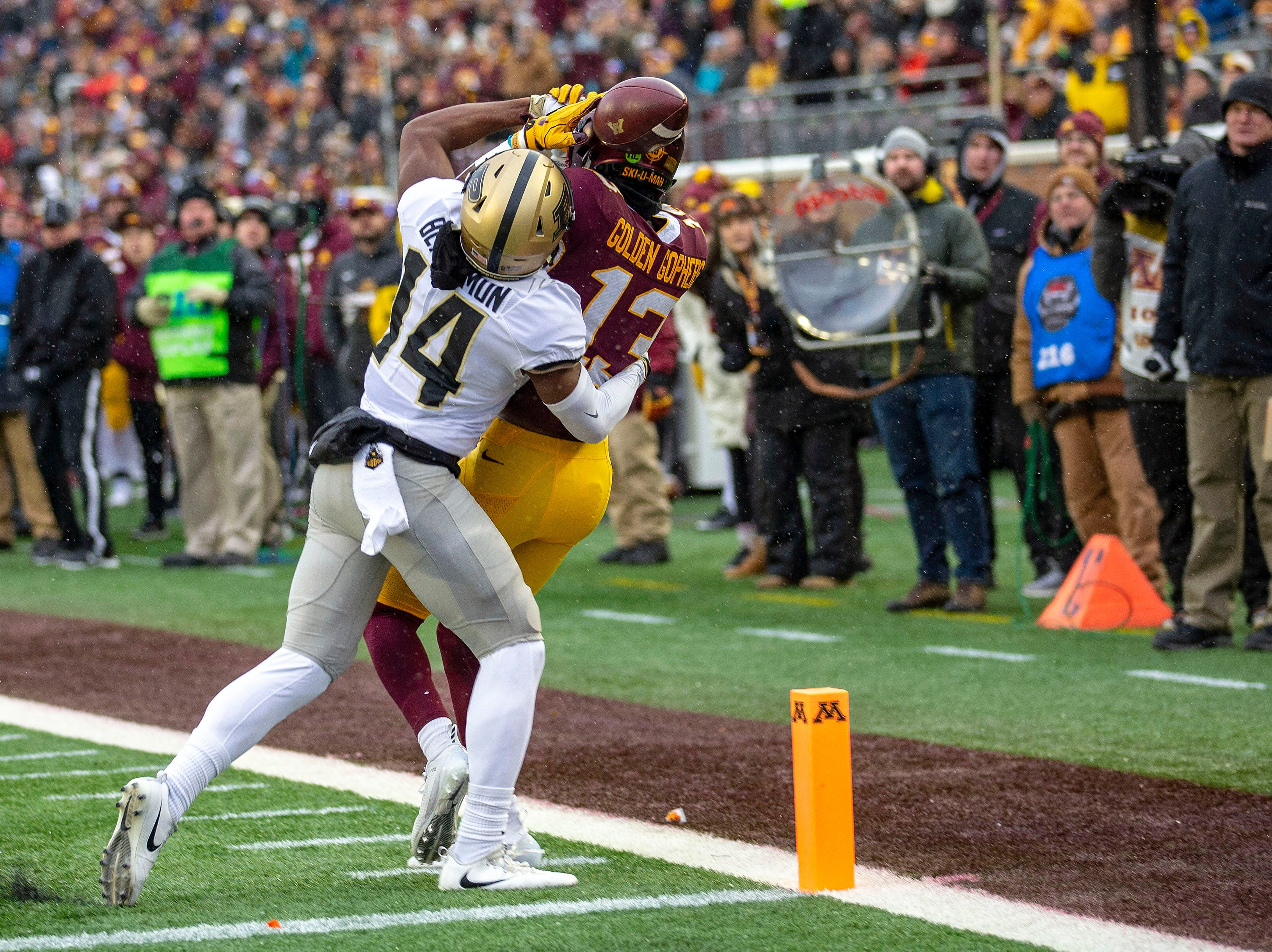 Nov 10, 2018; Minneapolis, MN, USA; Minnesota Golden Gophers wide receiver Rashod Bateman (13) attempts to catch a pass at the goalie as Purdue Boilermakers cornerback Antonio Blackmon (14) plays defense in the first half at TCF Bank Stadium. Mandatory Credit: Jesse Johnson-USA TODAY Sports