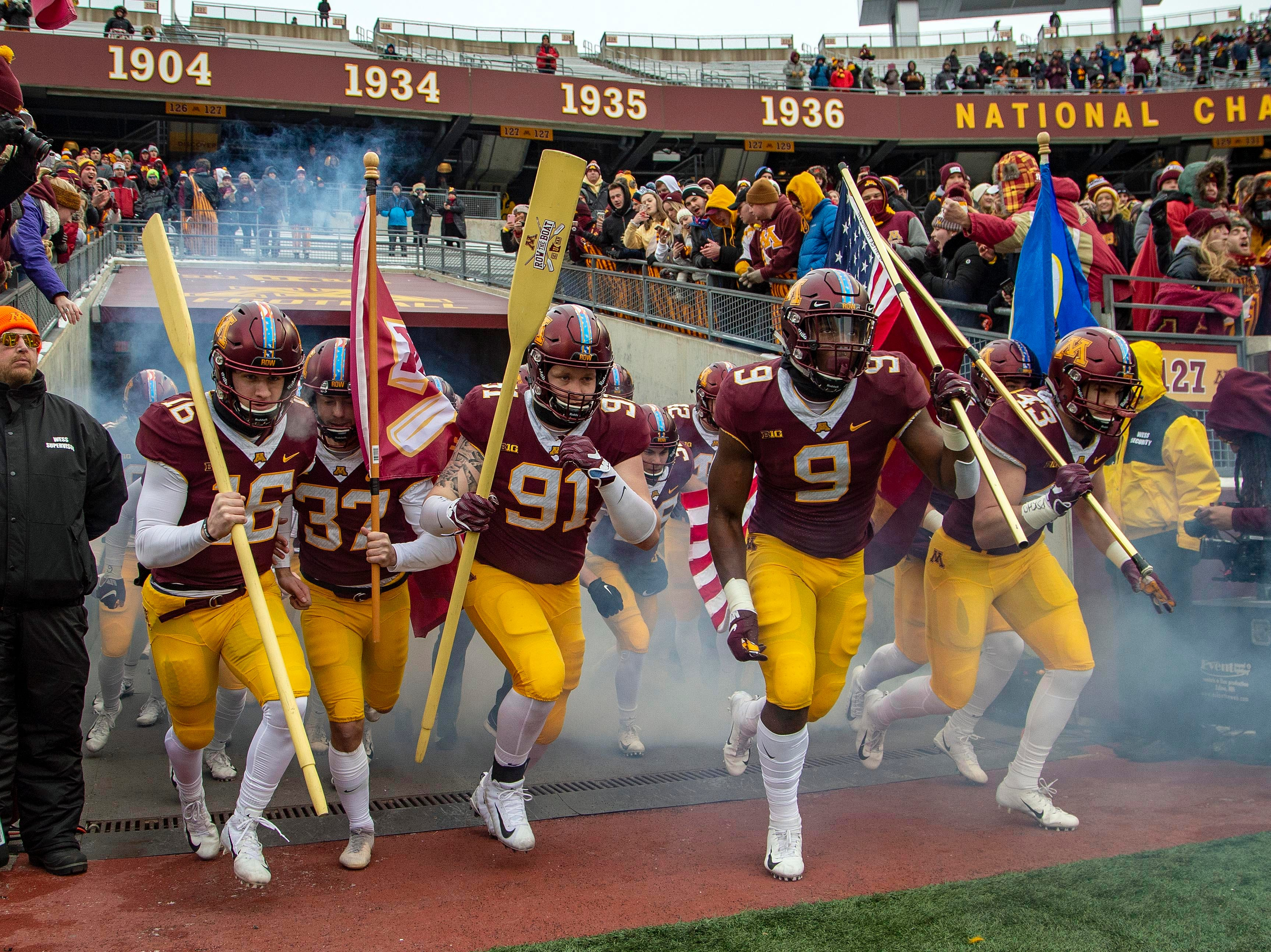 Nov 10, 2018; Minneapolis, MN, USA; Minnesota Golden Gophers run onto the field before a game against the Purdue Boilermakers at TCF Bank Stadium. Mandatory Credit: Jesse Johnson-USA TODAY Sports