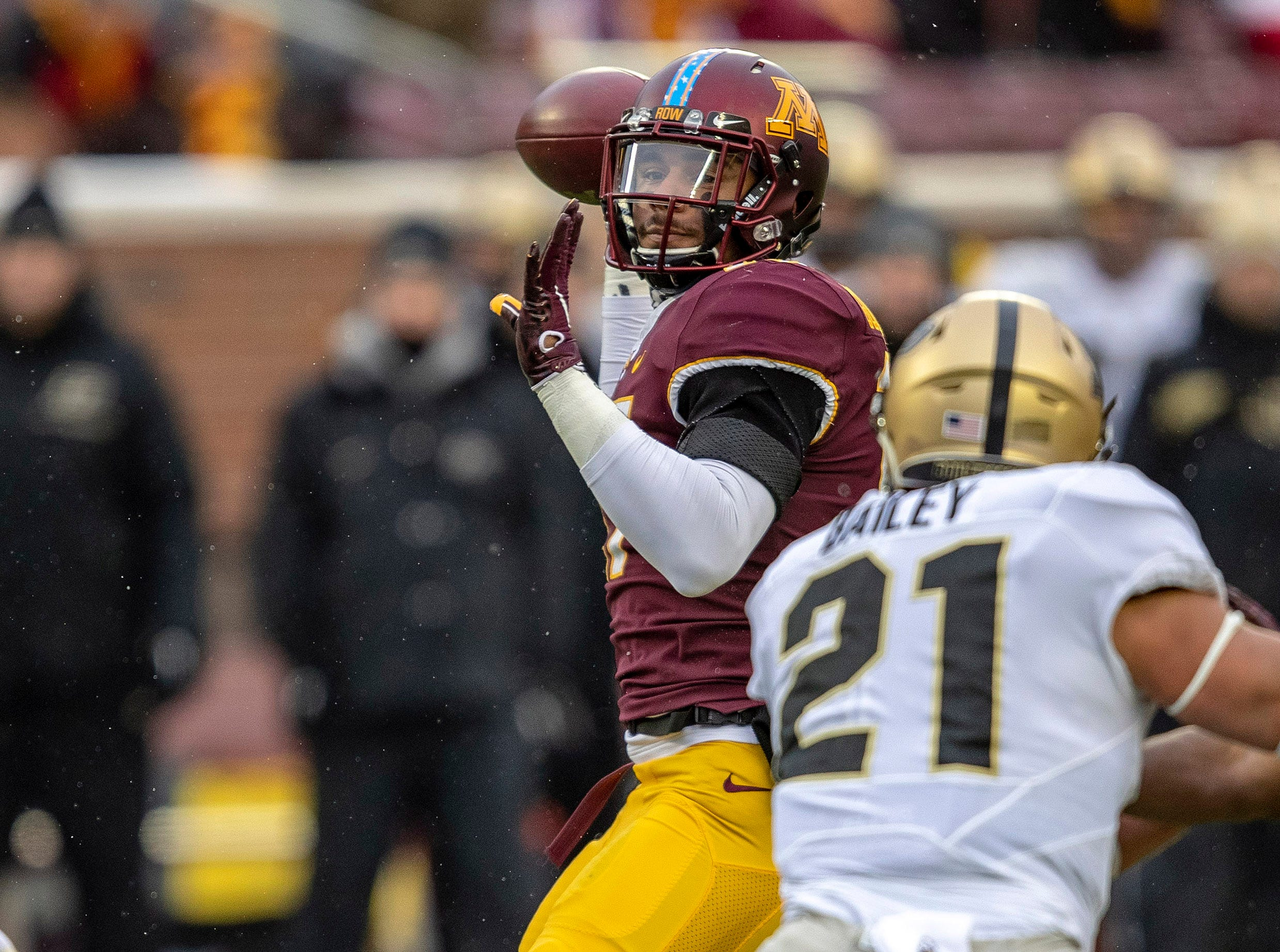 Nov 10, 2018; Minneapolis, MN, USA; Minnesota Golden Gophers wide receiver Seth Green (17) drops back and throws a touchdown pass in the first half against the Purdue Boilermakers at TCF Bank Stadium. Mandatory Credit: Jesse Johnson-USA TODAY Sports