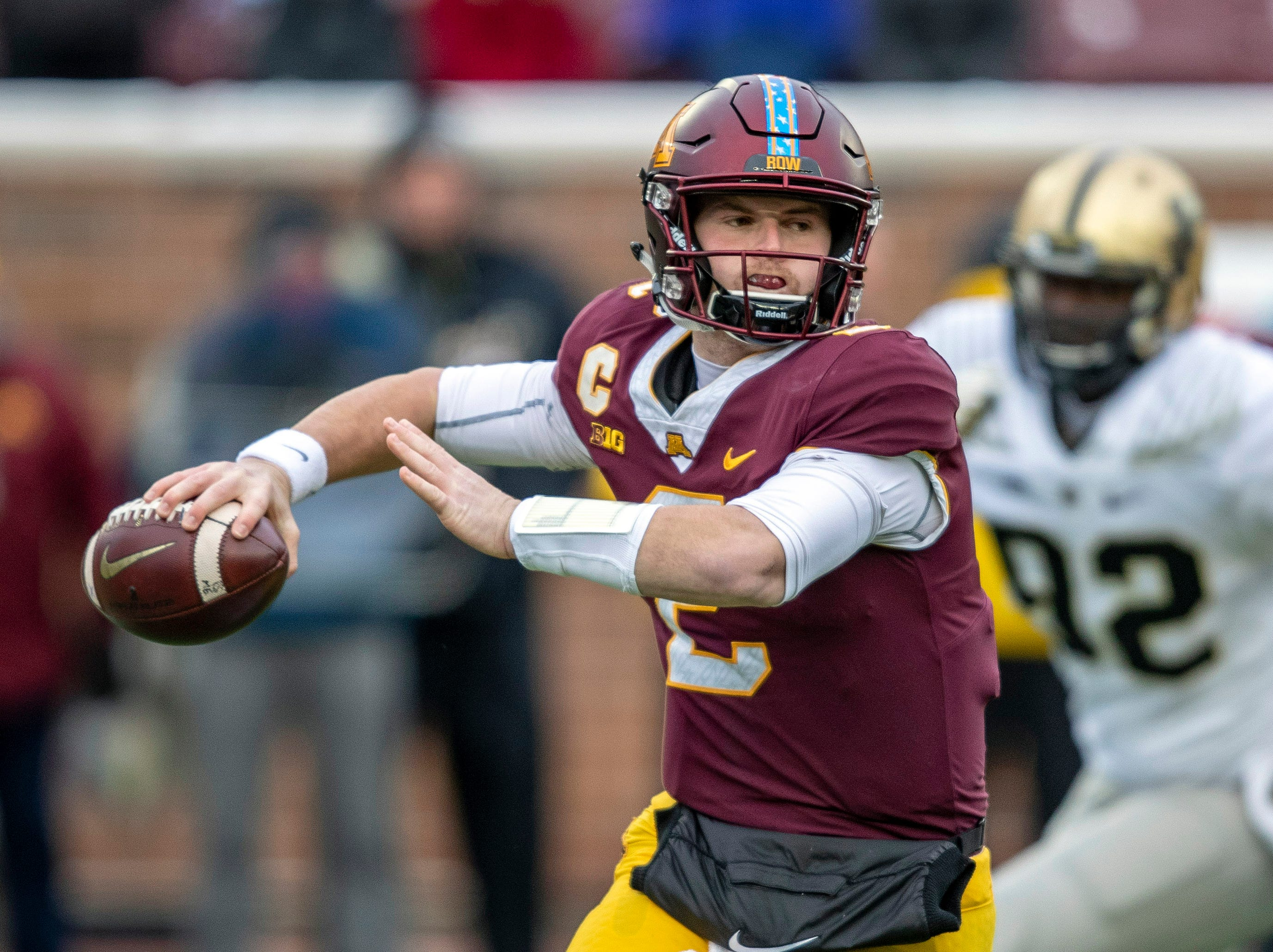 Nov 10, 2018; Minneapolis, MN, USA; Minnesota Golden Gophers quarterback Tanner Morgan (2) drops back for a pass in the first quarter against the Purdue Boilermakers at TCF Bank Stadium. Mandatory Credit: Jesse Johnson-USA TODAY Sports