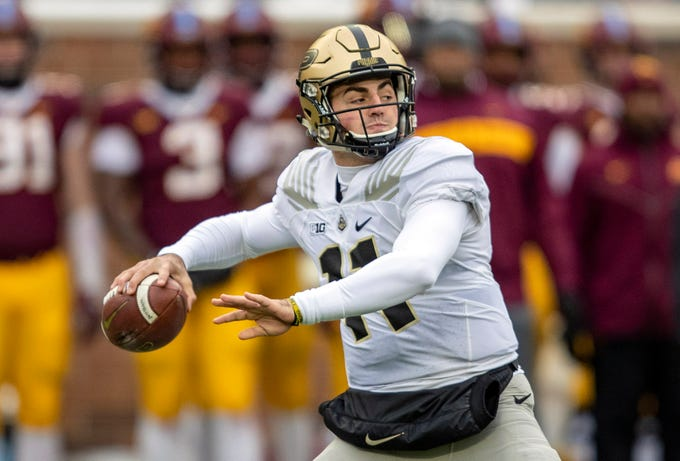 Nov 10, 2018; Minneapolis, MN, USA; Purdue Boilermakers quarterback David Blough (11) drops back for a pass in the first quarter against the Minnesota Golden Gophers at TCF Bank Stadium. Mandatory Credit: Jesse Johnson-USA TODAY Sports