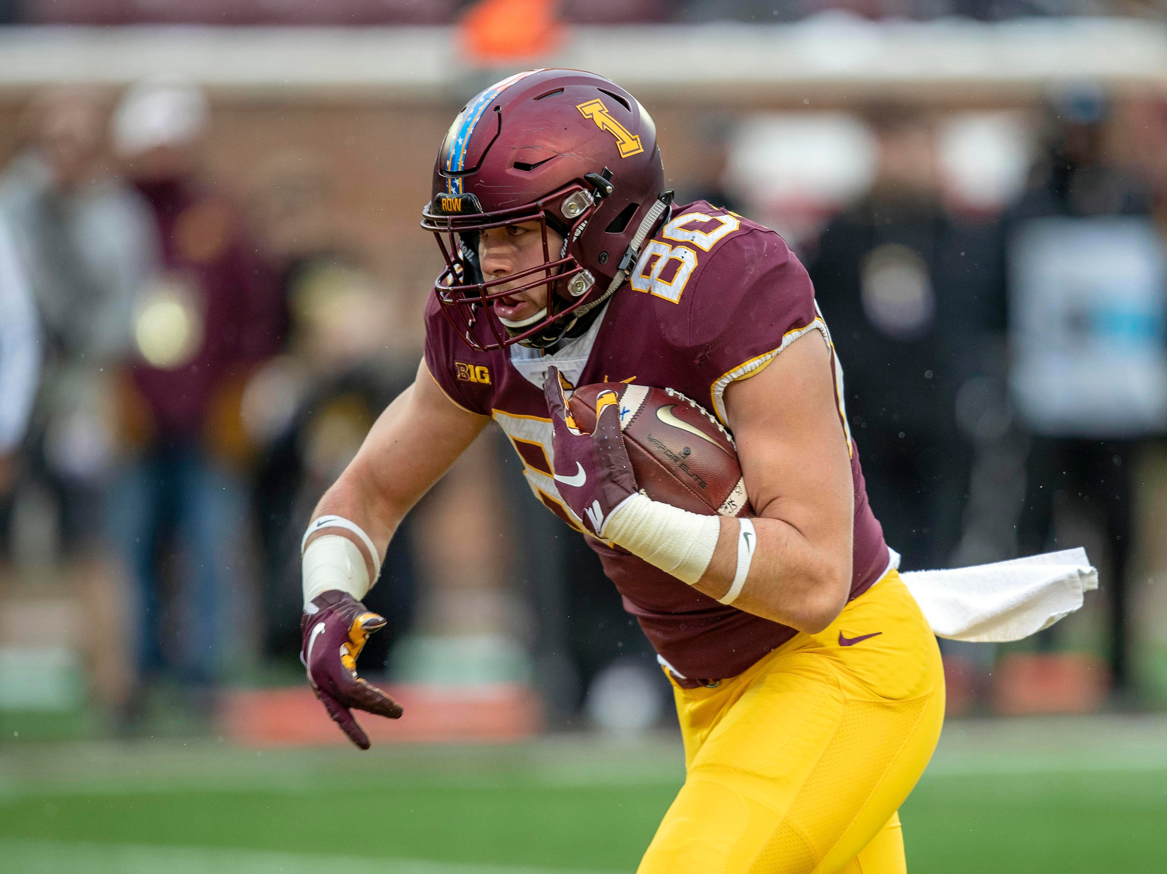 Nov 10, 2018; Minneapolis, MN, USA; Minnesota Golden Gophers tight end Jake Paulson (80) rushes for a touchdown in the first half against the Purdue Boilermakers at TCF Bank Stadium. Mandatory Credit: Jesse Johnson-USA TODAY Sports