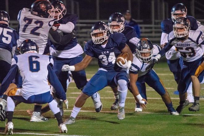 LCA's Logan Gabriel moves the ball down the field as the Lafayette Christian Academy Knights take on the Houma Christian Warriors at Clark Field in the first round of the high school football playoffs Friday Nov. 9, 2018.