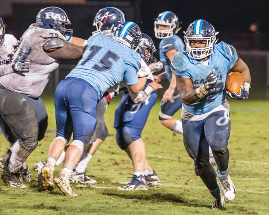 Ascension's Jhalen Brown (22) runs the ball toward the end zone as the Blue Gators host the Riverside Academy Rebels in the first round of the Division III LHSAA football playoffs Friday Nov. 9, 2018.