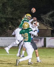Acadiana's defense shakes loose the ball during the Rams' 22-7 win over Live Oak on Friday at Bill Dotson Stadium.