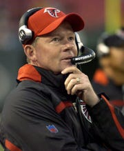 Atlanta Falcons coach Bobby Petrino looks up at the scoreboard during first-quarter NFL pre-season football against the New York Jets, in this Aug. 10, 2007 file photo at Giants Stadium in East Rutherford, N.J.  A person close to the team told The Associated Press Tuesday, Dec. 11, 2007, Petrino has resigned as the Falcons head coach.