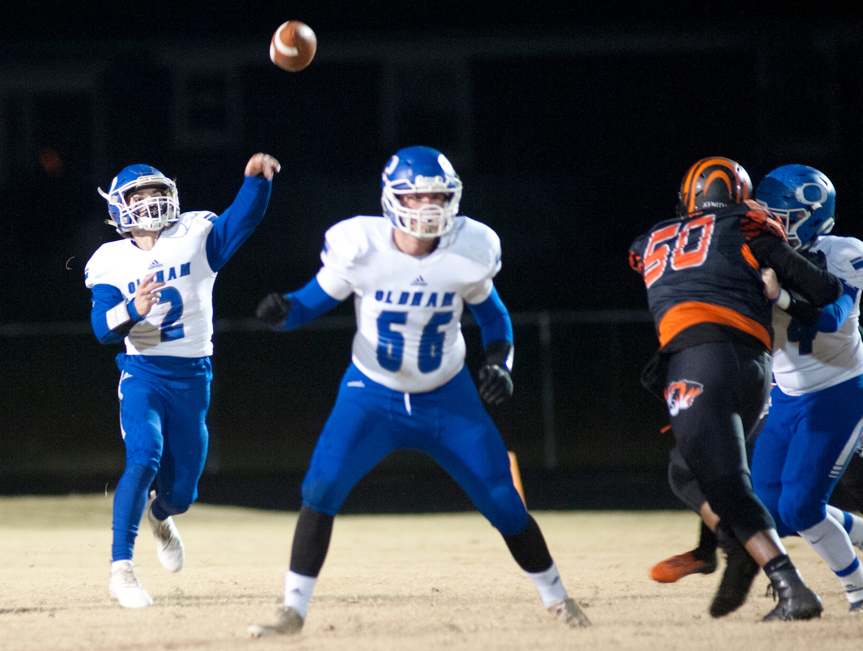 Oldham County quarterback Parker Caudill gets a pass off during the game. Nov. 9, 2018