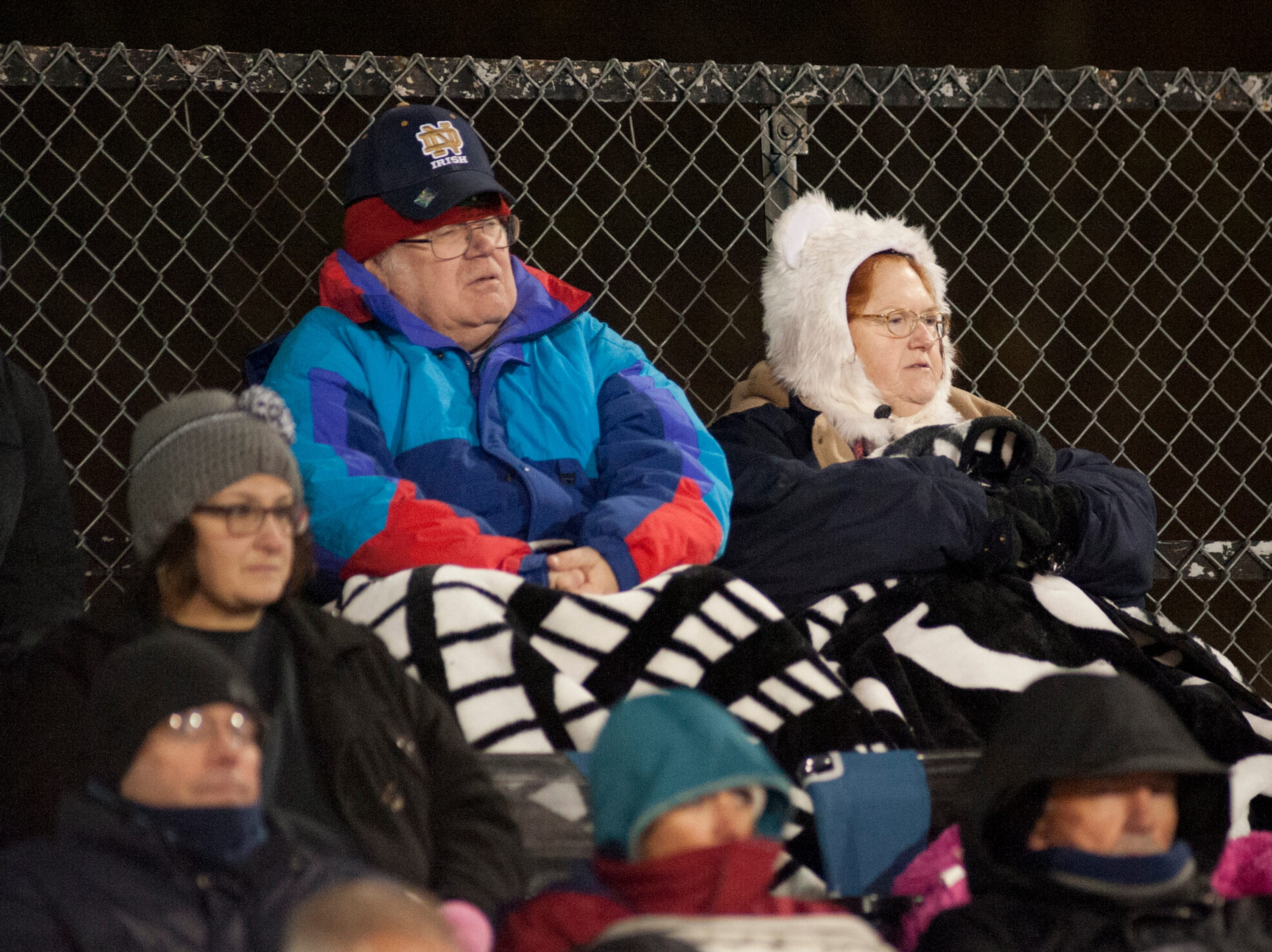 Oldham County fans bundle up from the cold to watch their team take on Oldham County in the Class 5A Region 2 semifinal at Fern Creek. Nov. 9, 2018