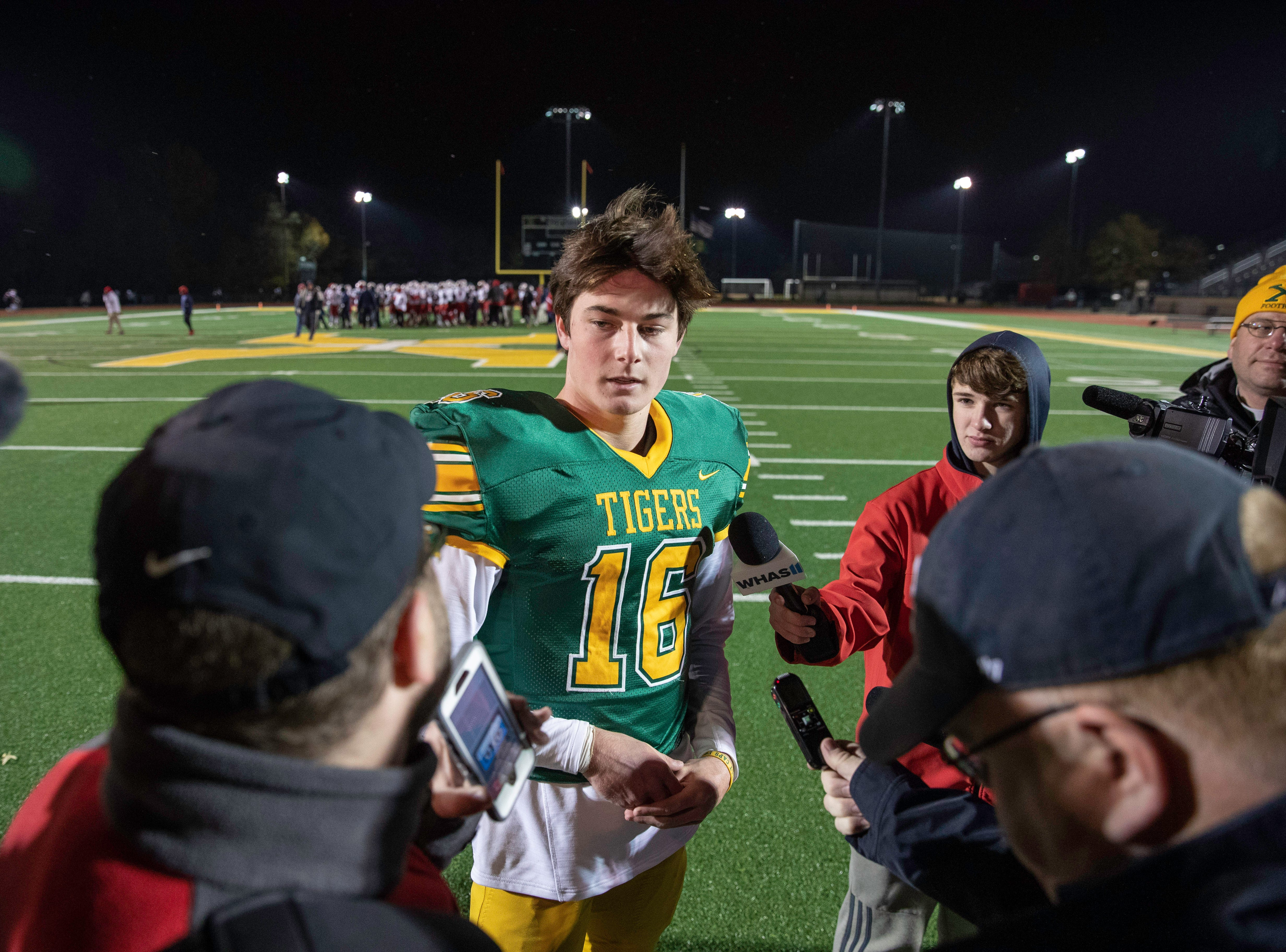 St. X senior Jude Carlon speaks with media after the Tigers defeated the Butler Bears 35-20 in the KHSAA regional playoff game at St. Xavier High School, Friday, Nov. 9, 2018. Carlon tallied his fourth takeaway of the season tonight, all four coming against Butler.