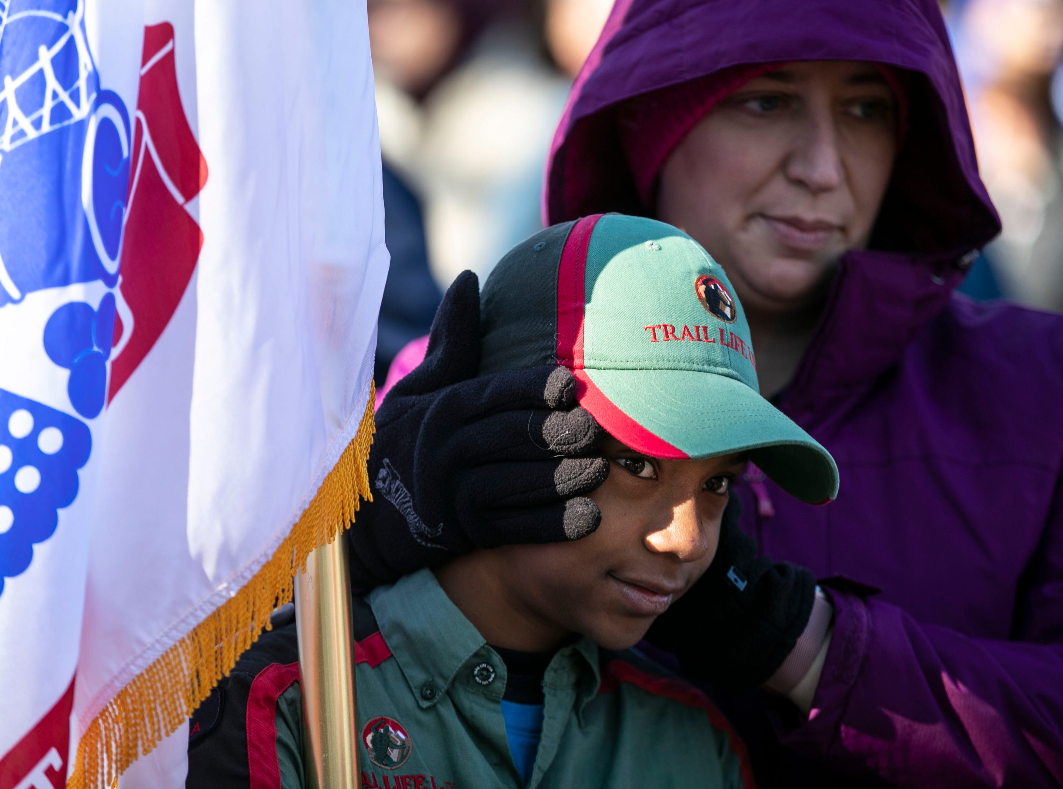 Daryn Kennedy tries to keep the ears of her son Jake warm before the start of a short walk to Cave Hill Cemetery as a remembrance to military veterans during a Flags 4 Vets event Saturday, Nov. 10, 2018. Veterans Day is Sunday, Nov. 11. Around 250 volunteers placed nearly 7,500 flags on military veteran gravesites.