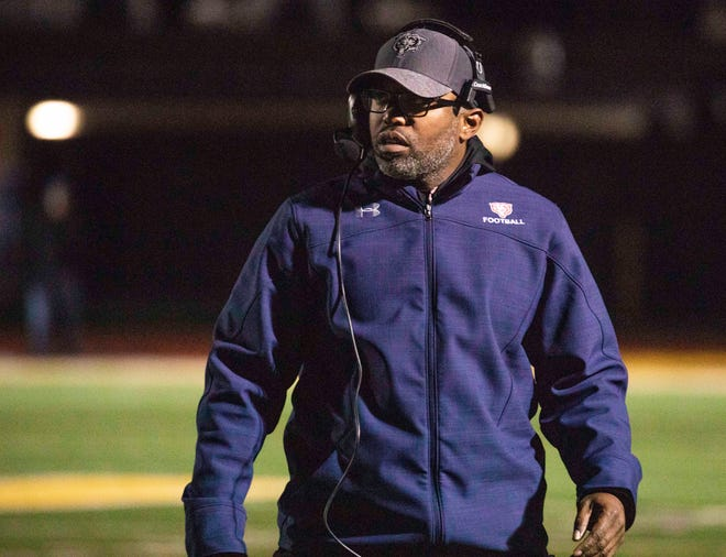 Butler Head Coach Gary Wheeler paces the sideline during the first half of the KHSAA regional playoff game at St. Xavier High School, Friday, Nov. 9, 2018.