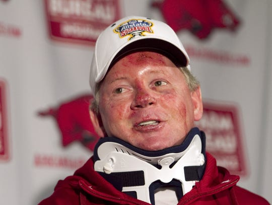 Arkansas football coach Bobby Petrino speaks during a news conference in Fayetteville, Ark., after being released from a hospital after he was injured in a motorcycle accident. A person familiar with the situation says Petrino is out as coach at Arkansas.