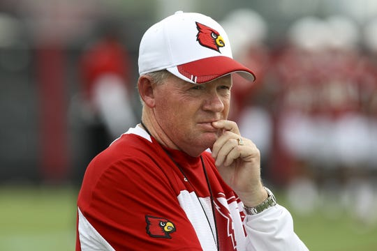 Bobby Petrino watches his team during practice.
