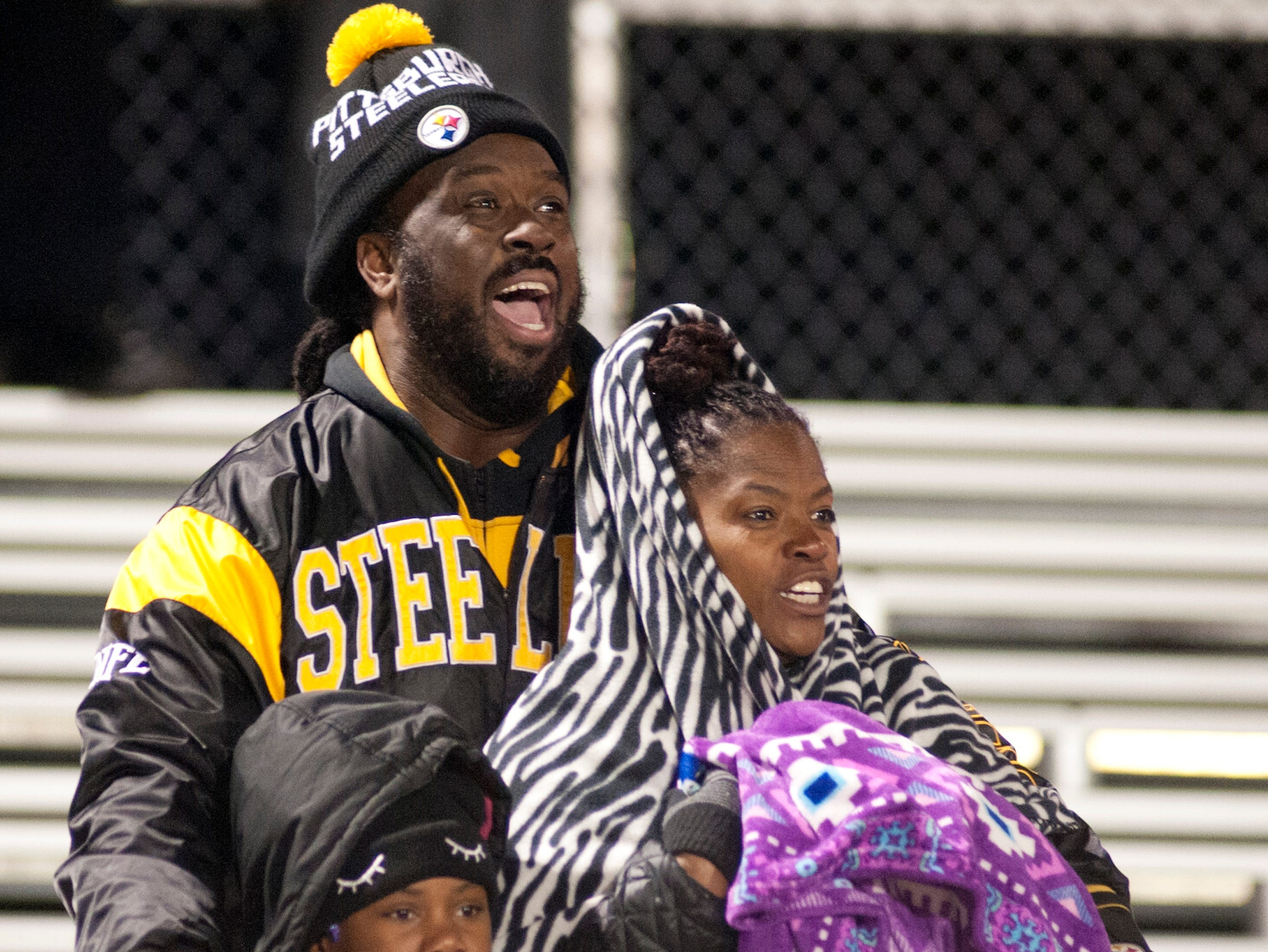 Fern Creek fans bundle up from the cold to watch their team take on Oldham County in the Class 5A Region 2 semifinal at Fern Creek. Nov. 9, 2018