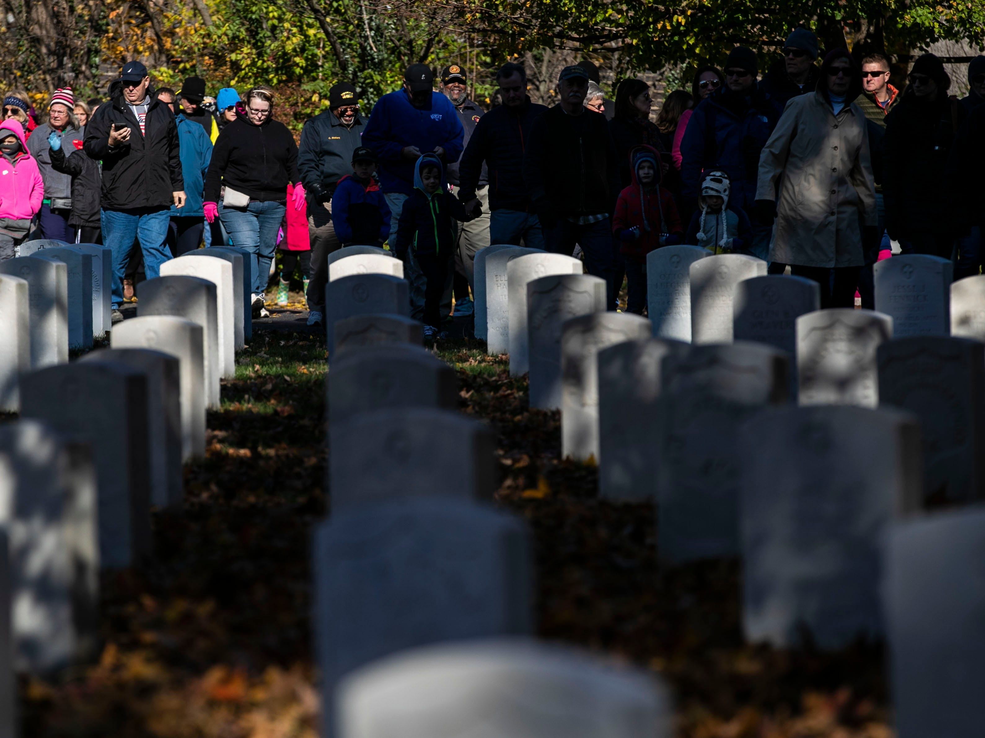 There was a short walk to Cave Hill Cemetery as a remembrance to military veterans during a Flags 4 Vets event Saturday, Nov. 10, 2018. Veterans Day is Sunday, Nov. 11. Around 250 volunteers placed nearly 7,500 flags on military veteran gravesites.