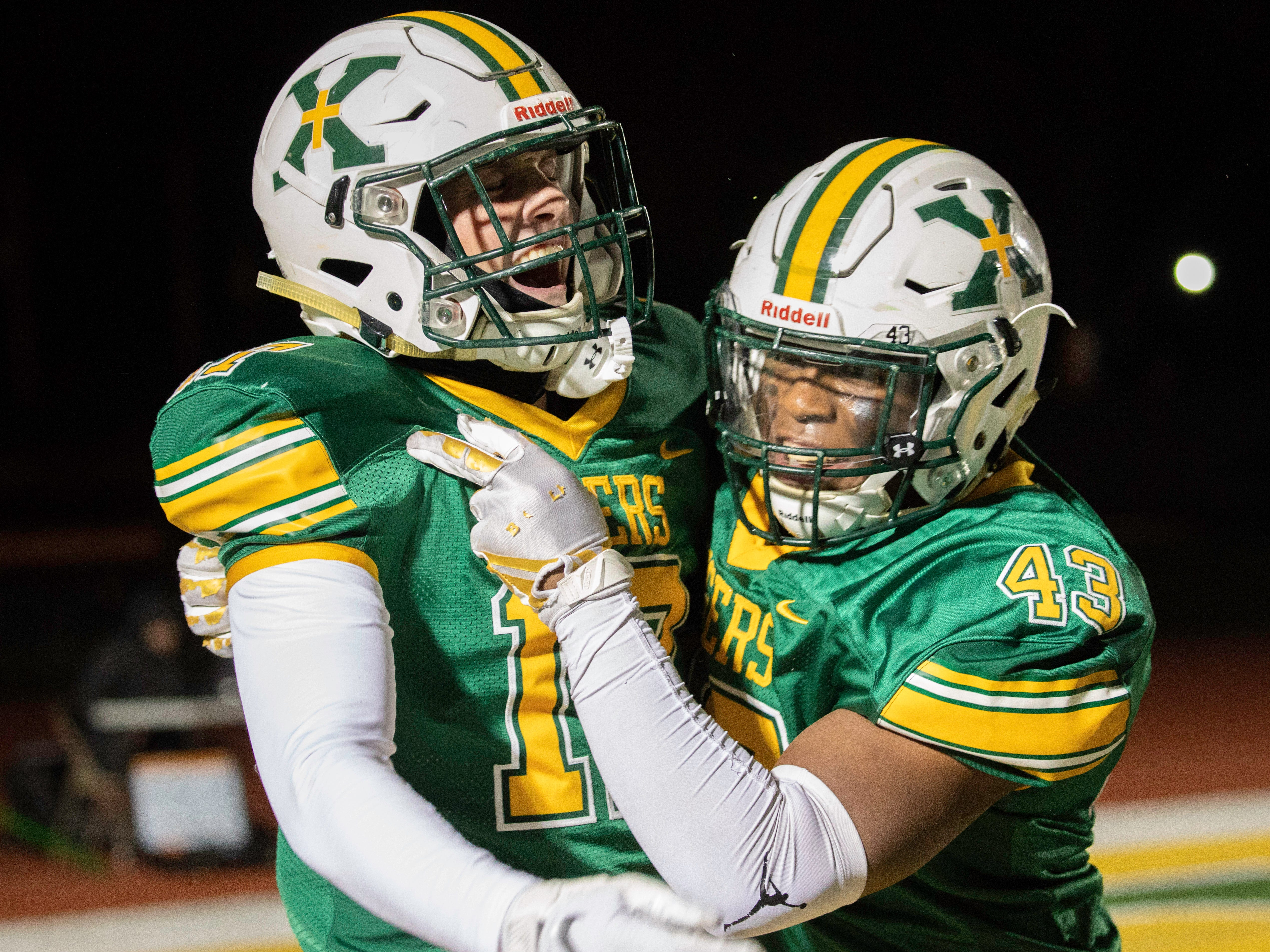 Sam Boarman and Camren Sams celebrate Boarman's interception for a touchdown defeating Butler in the KHSAA regional playoff game 35-20 at St. Xavier High School, Friday, Nov. 9, 2018.