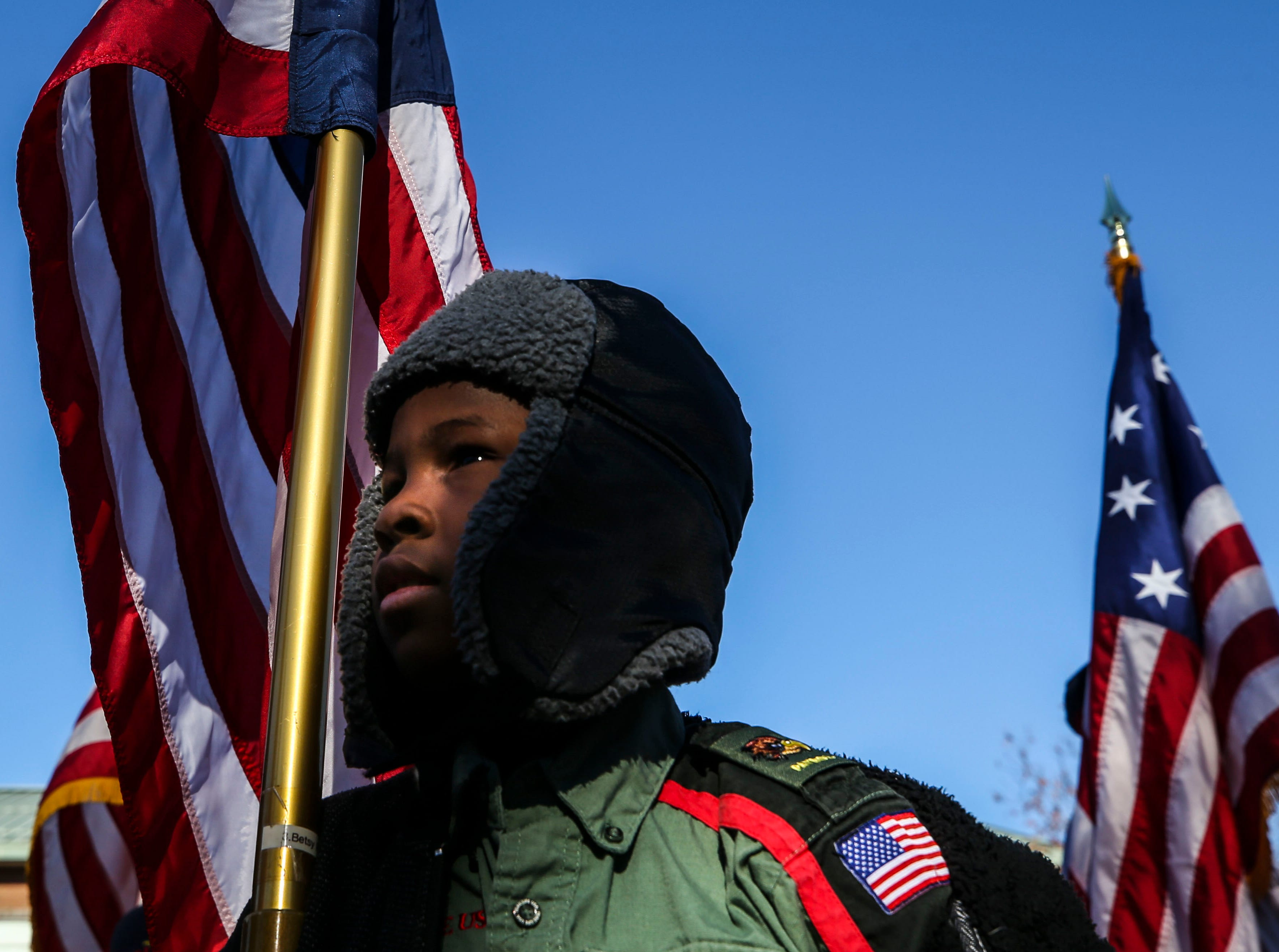 Trail Life scout Xander Roberts, 8, waits during the Flags 4 Vets ceremony at Cave Hill Cemetery Saturday morning.