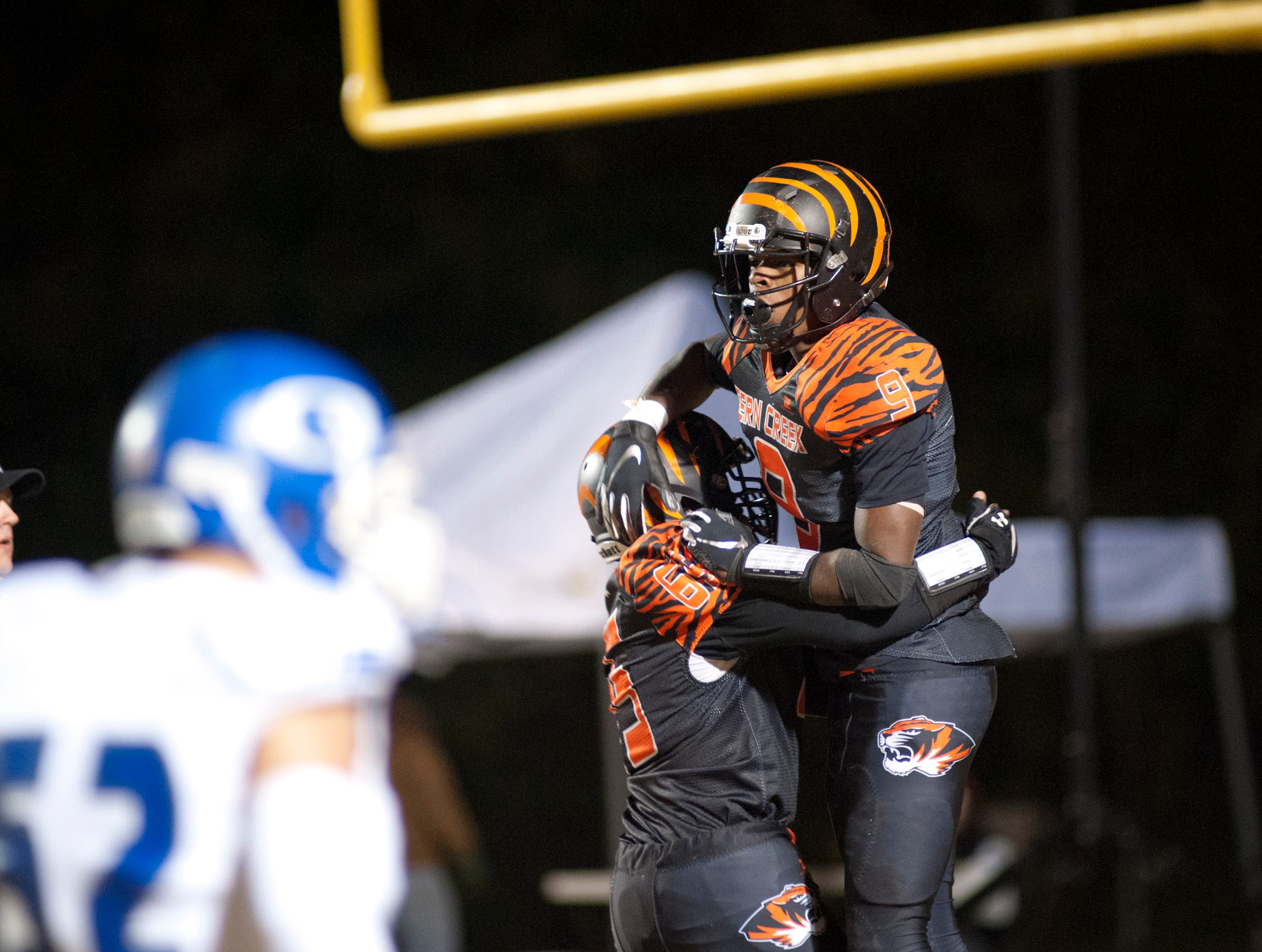 Fern Creek wide receiver William Neal, right, is hoisted up by teammate wide receiver Trayvon Holloway after Neal scores. Nov. 9, 2018