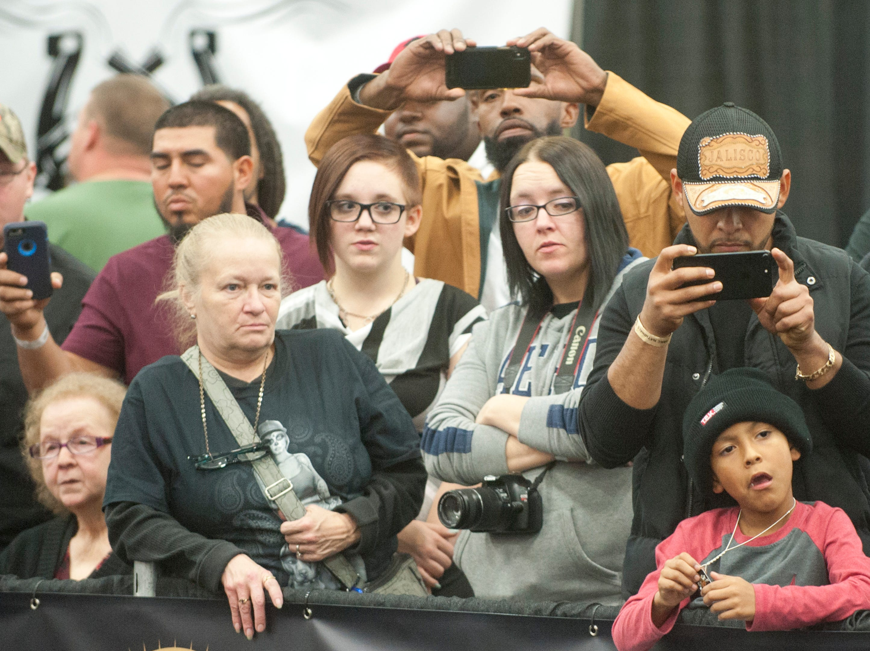 Fans watch and photograph the judging at the 2018 American Bully Kennel Club's 12th annual confirmation event at the Kentucky Convention Center in Louisville.November 10, 2018