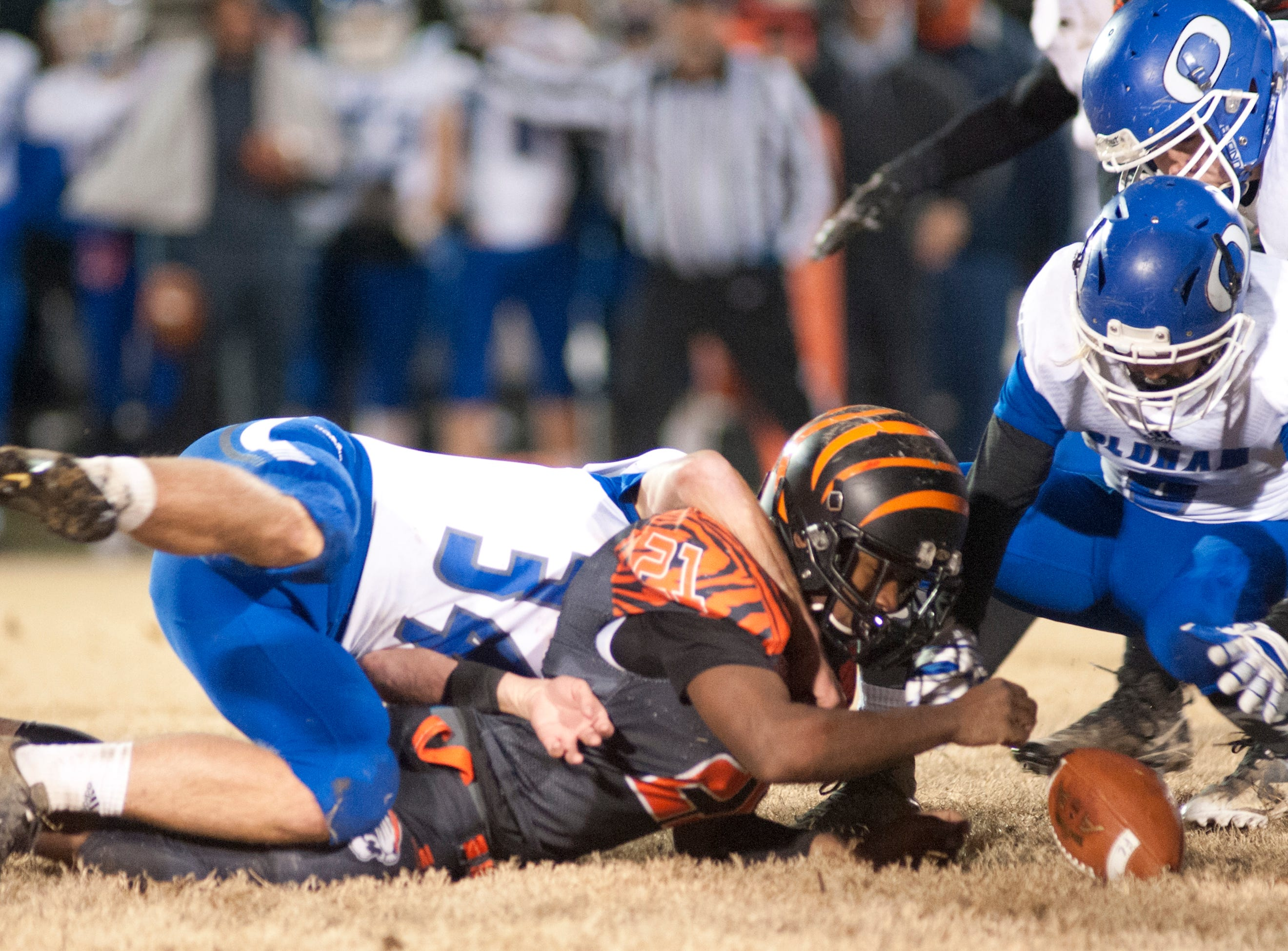 The ball comes loose from Fern Creek running back Terrance Mitchell and Oldham County recovers on their own 10-yard-line but they had to kick the ball away on consecutive downs. Nov. 9, 2018