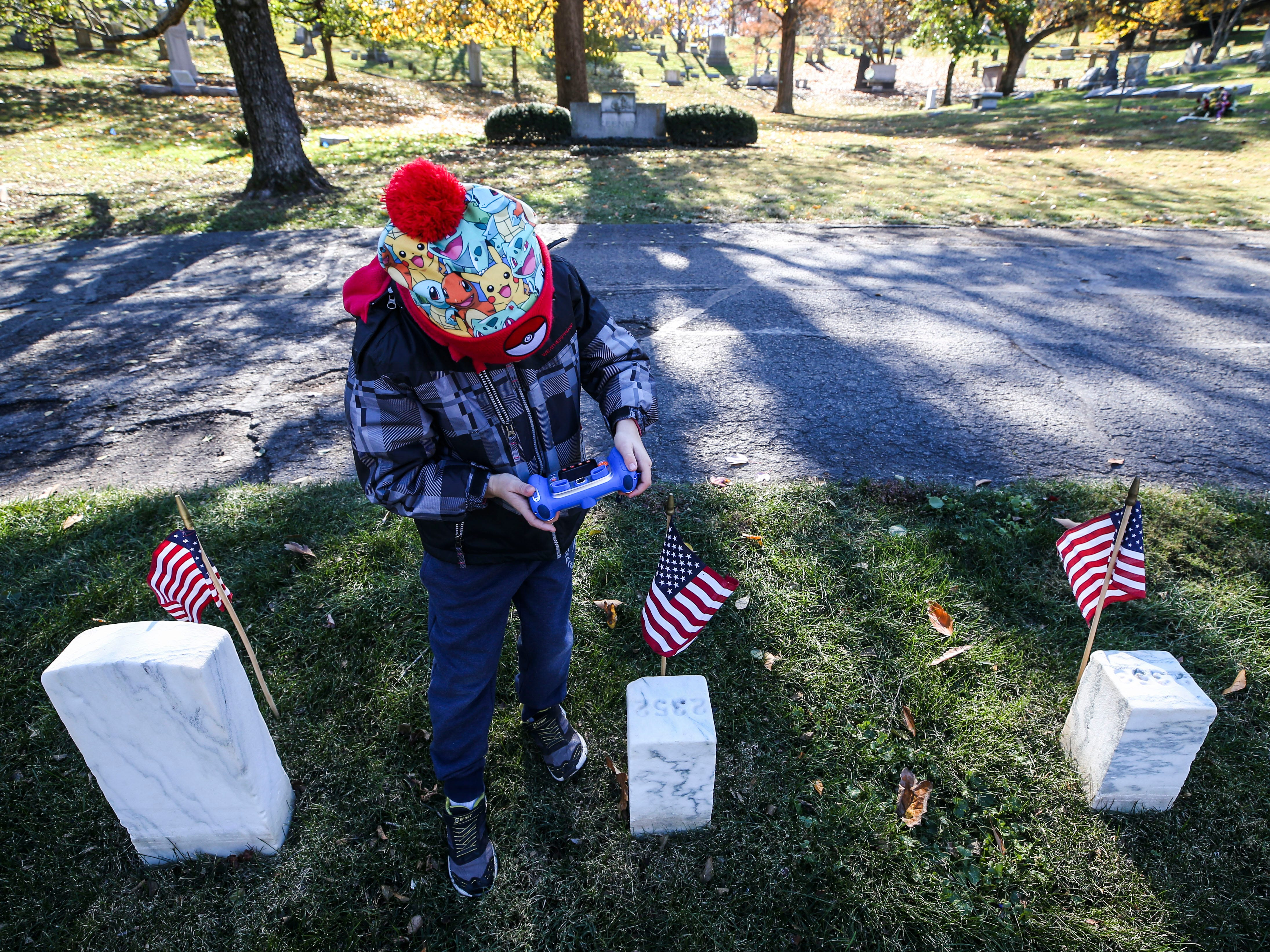 Scenes during the Flags 4 Vets ceremony at Cave Hill Cemetery Saturday morning.
