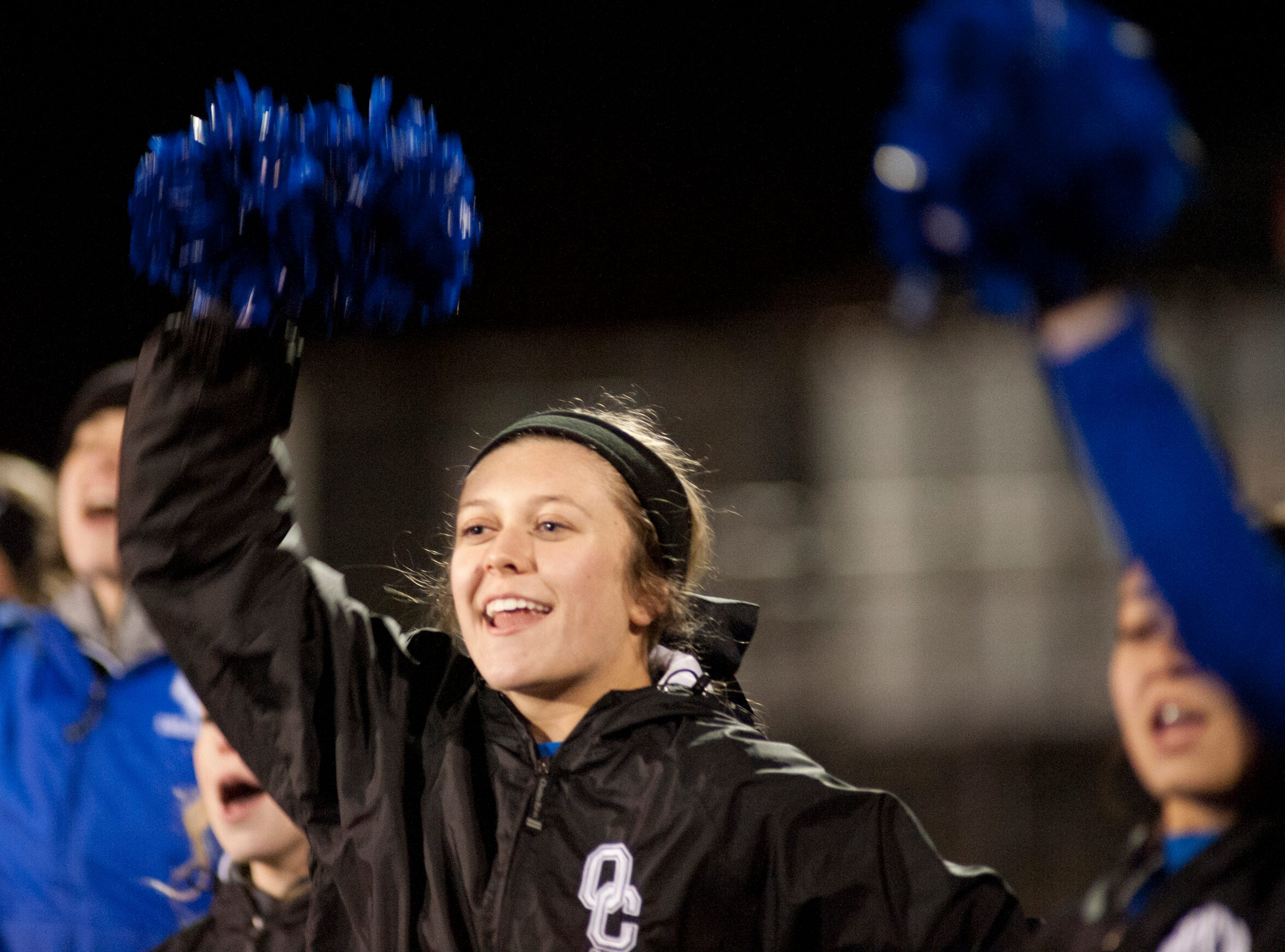 An Oldham County cheerleader roots for her team. Nov. 9, 2018