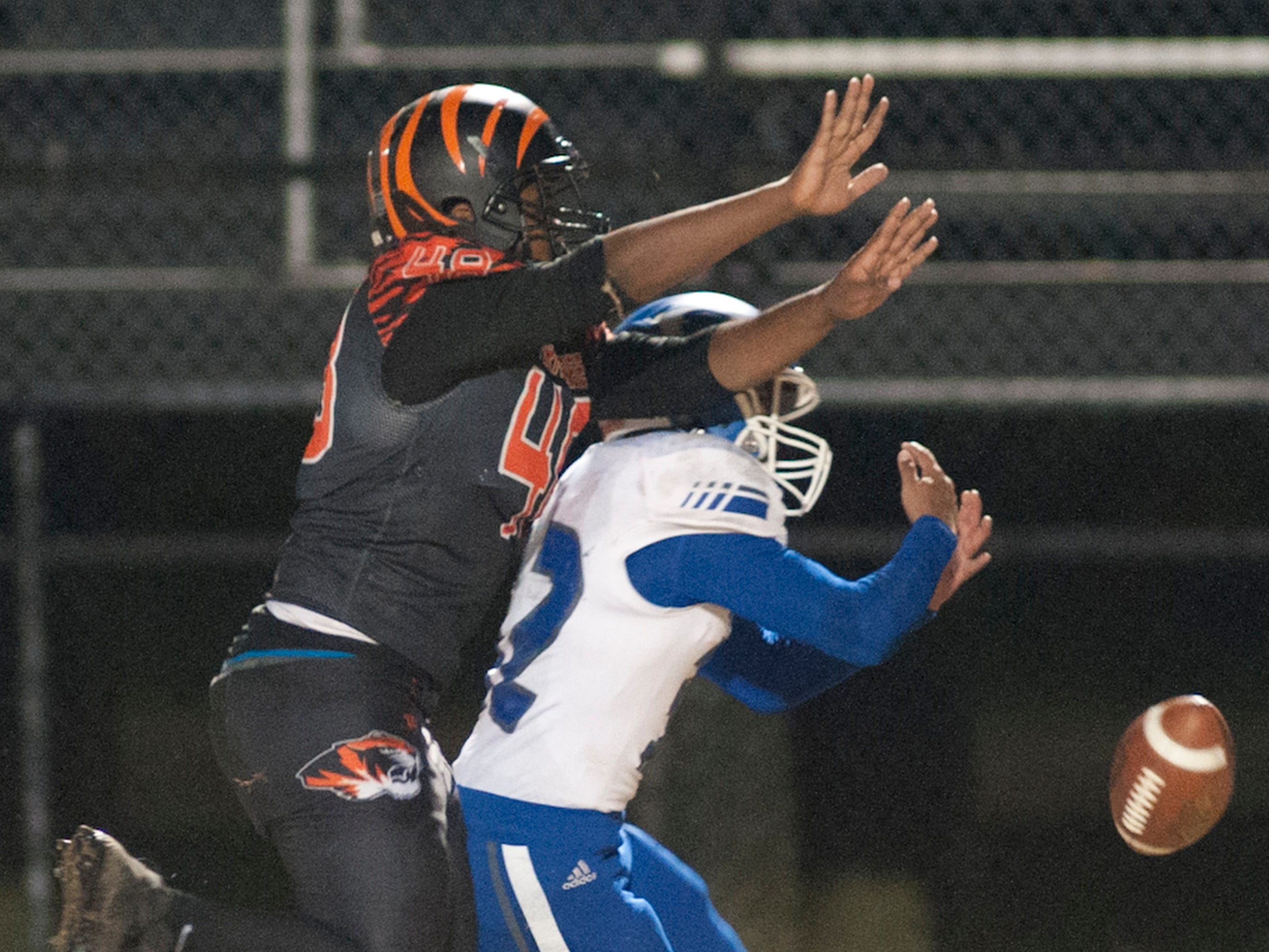 Fern Creek linebacker Larry Holt knocks the ball out of the hands of Oldham County's Lucas Jones. Nov. 9, 2018